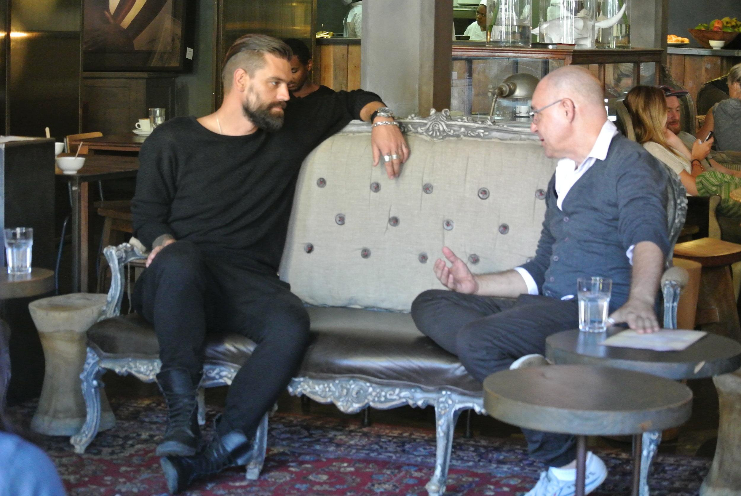 Brett chatting with Johan at Haas.JPG
