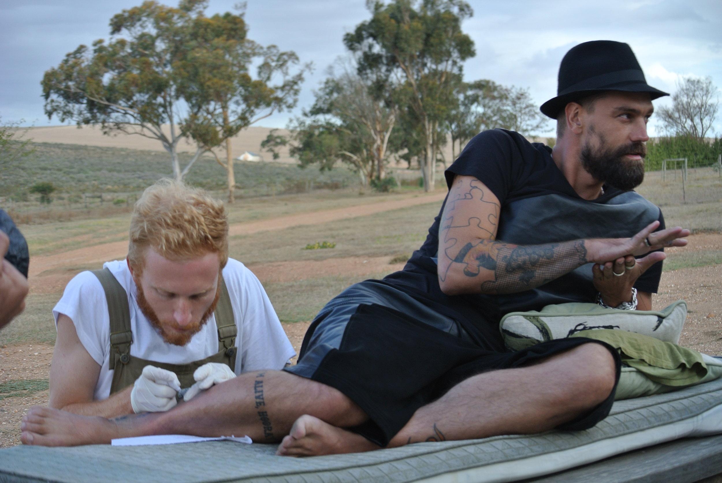 Brett getting tattooed by NinjaBreadBoy.JPG