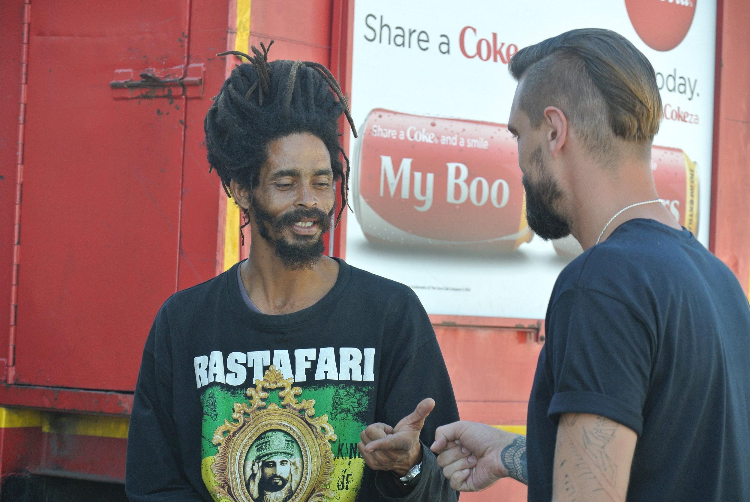 Brett chatting with one of knysnas Rasta Community.JPG