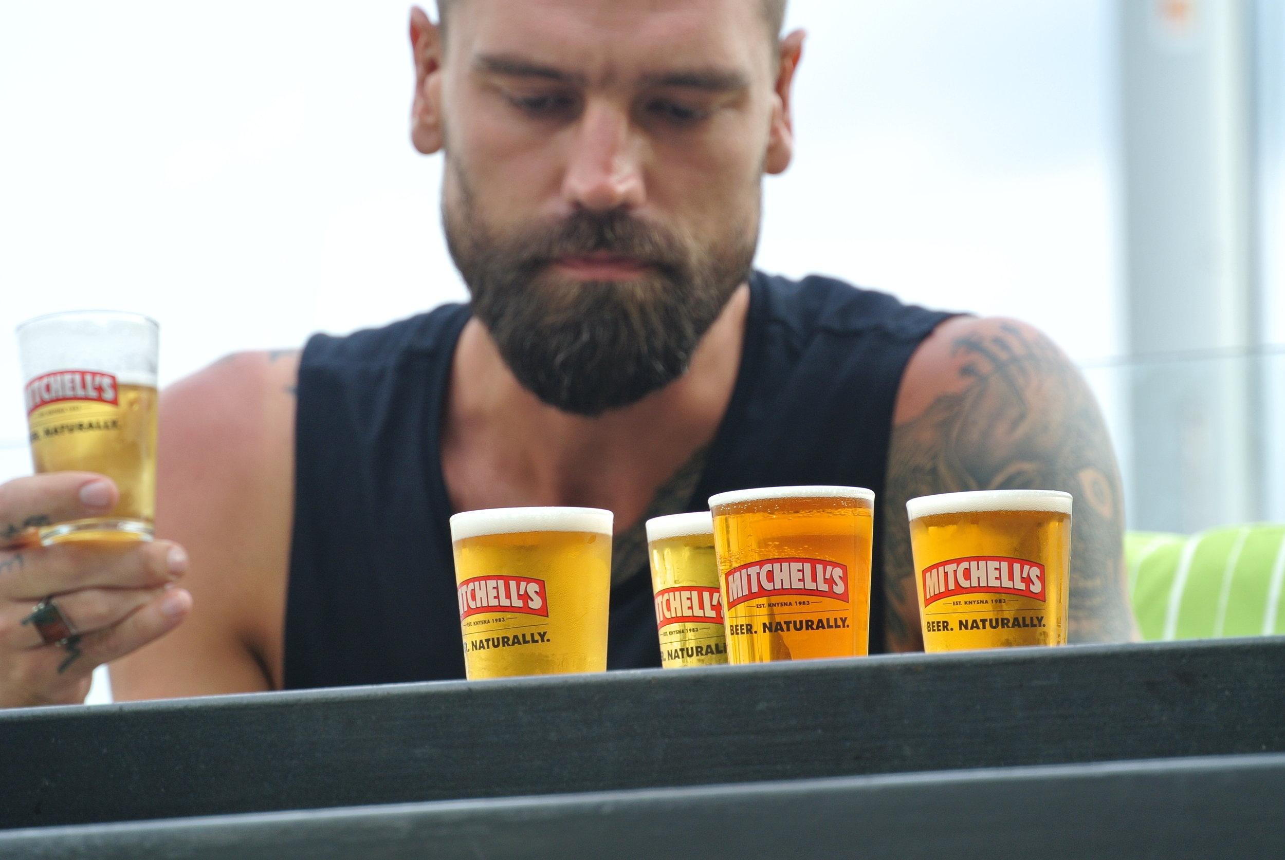 Brett drinking Mitchells in Knysna.JPG