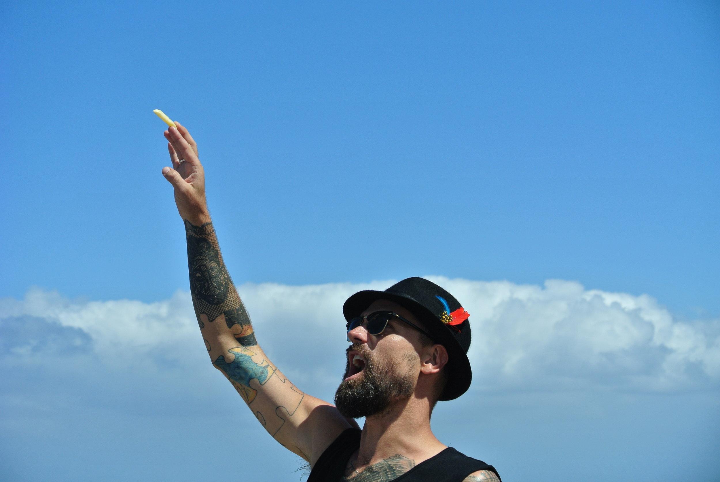 Brett attempting to feed Seagulls in Mossel Bay.JPG