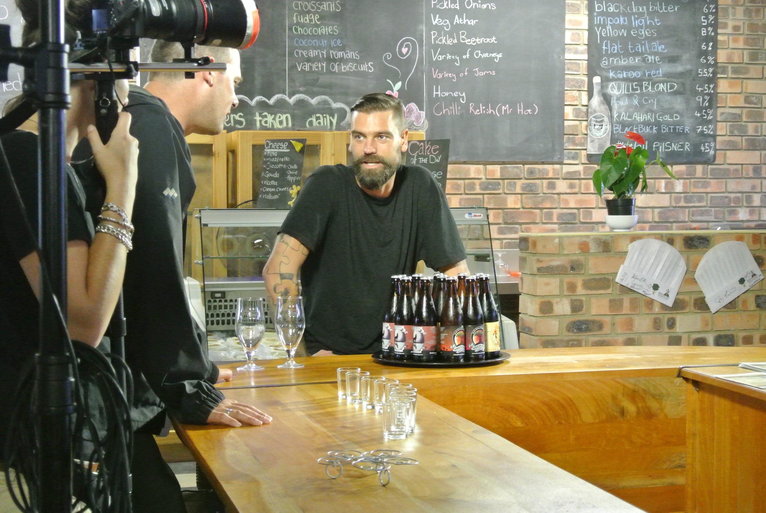 Brett waiting to drink Quill Beer.JPG