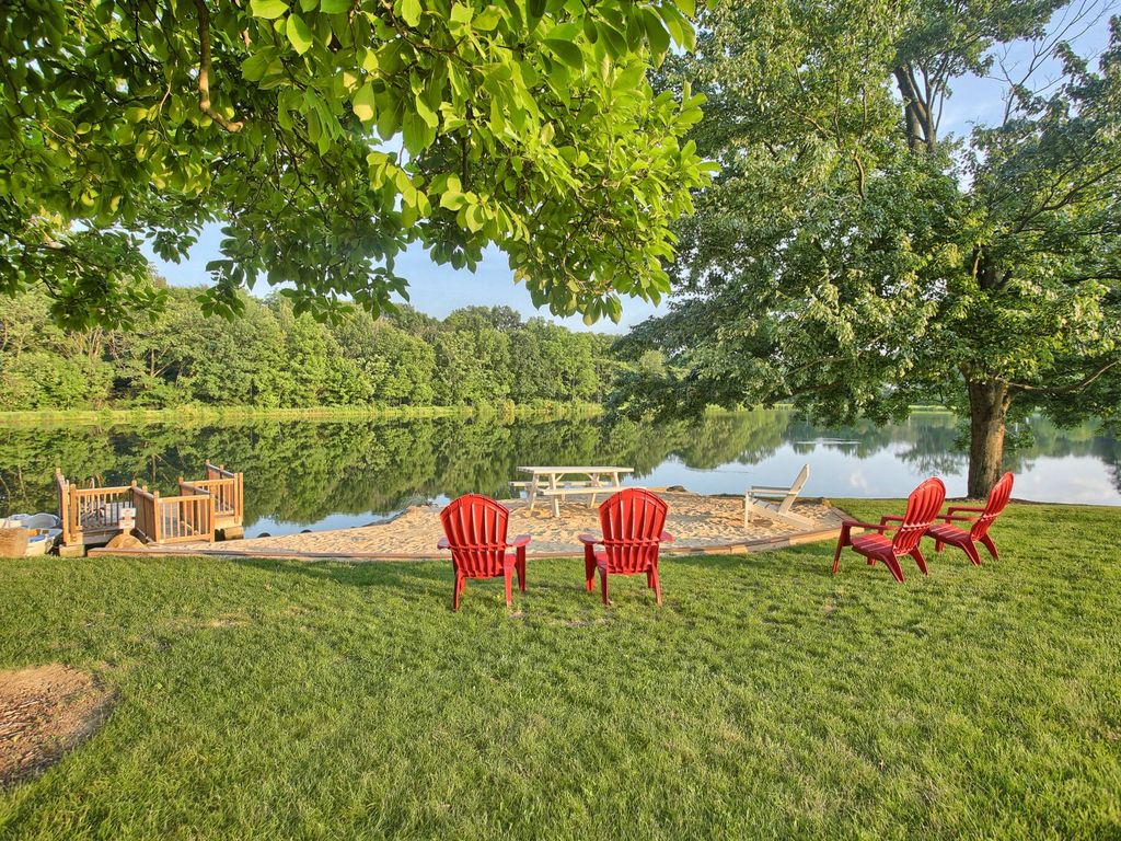 """THE beautiful """"backyard"""" of the retreat home, surrounded by hiking trails, private lake and boats and kayaks."""
