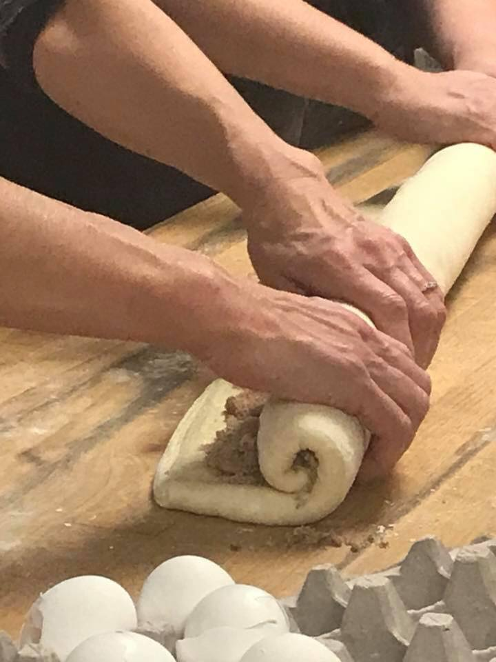 Shaping the cinnamon rolls
