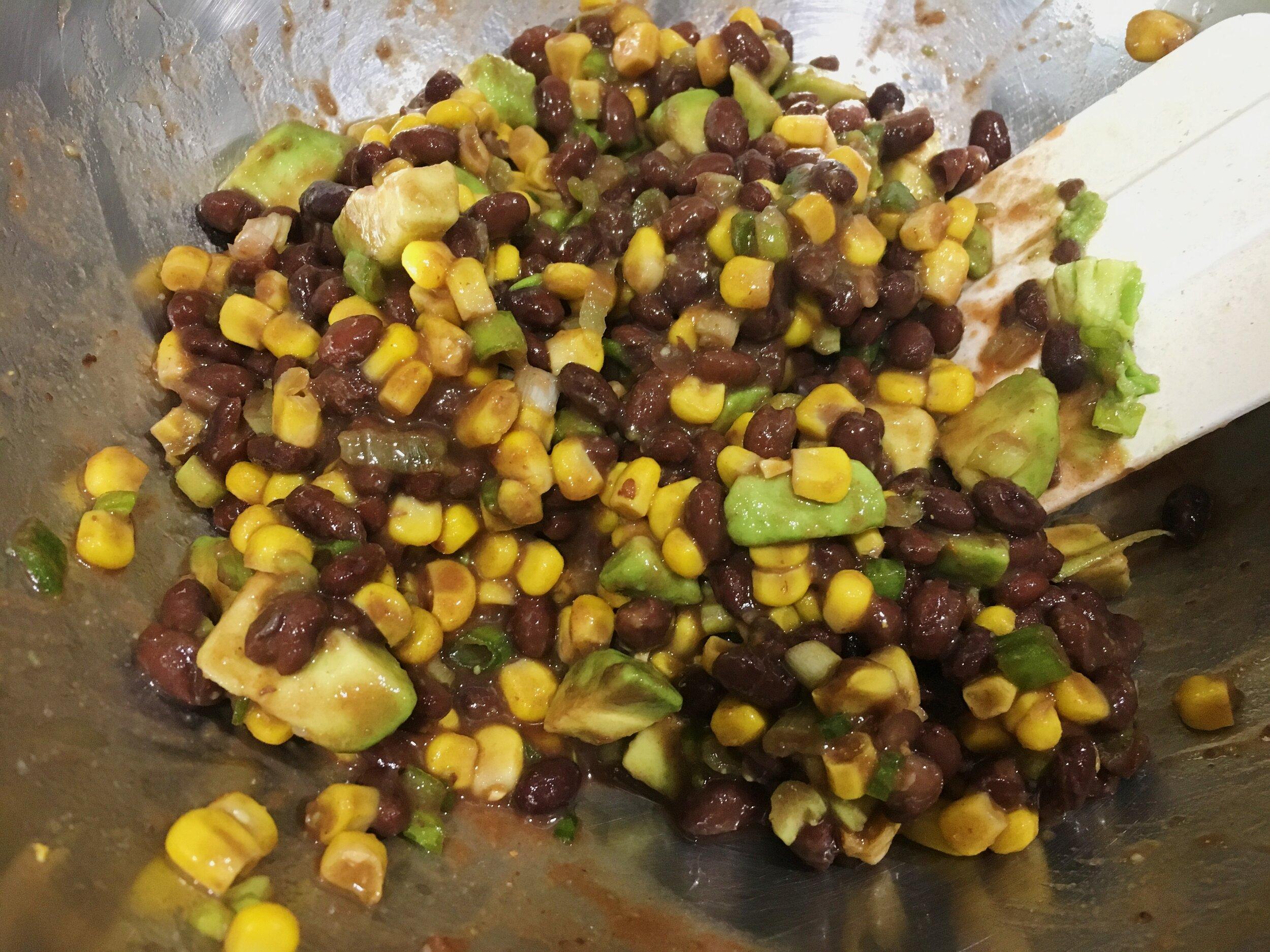 Step 2: - In a medium bowl, combine the black beans, corn, tomato sauce, scallions, cumin, cayenne, and salt.