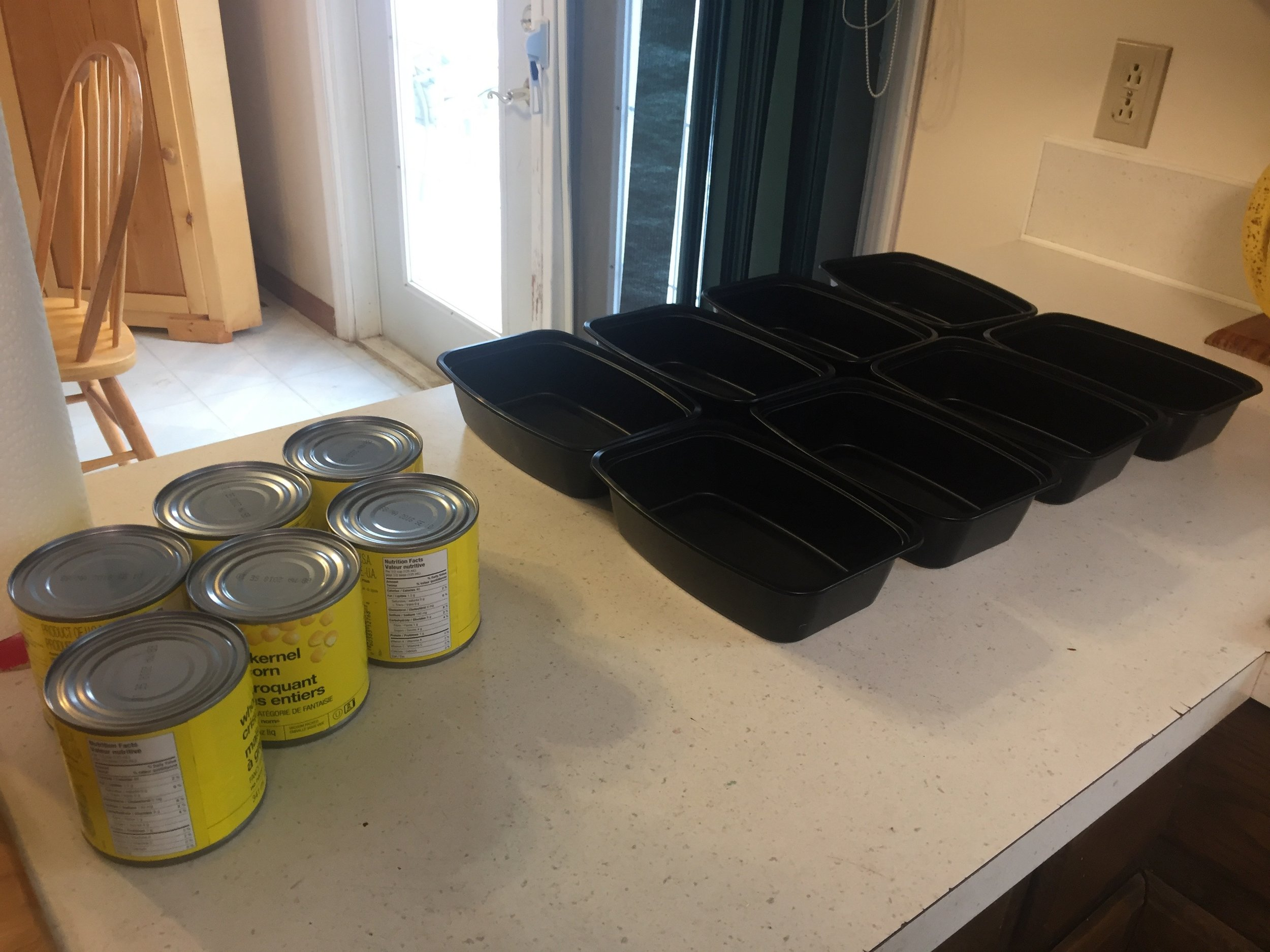 Got ahead of myself a little and set the containers out, waiting to be filled. Corn makes its first appearance.