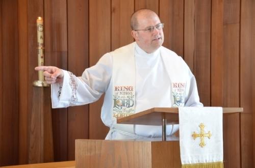 Rev. Koch preaches.JPG