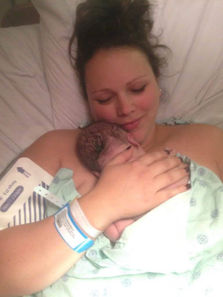 Alex Holding Newborn Declan