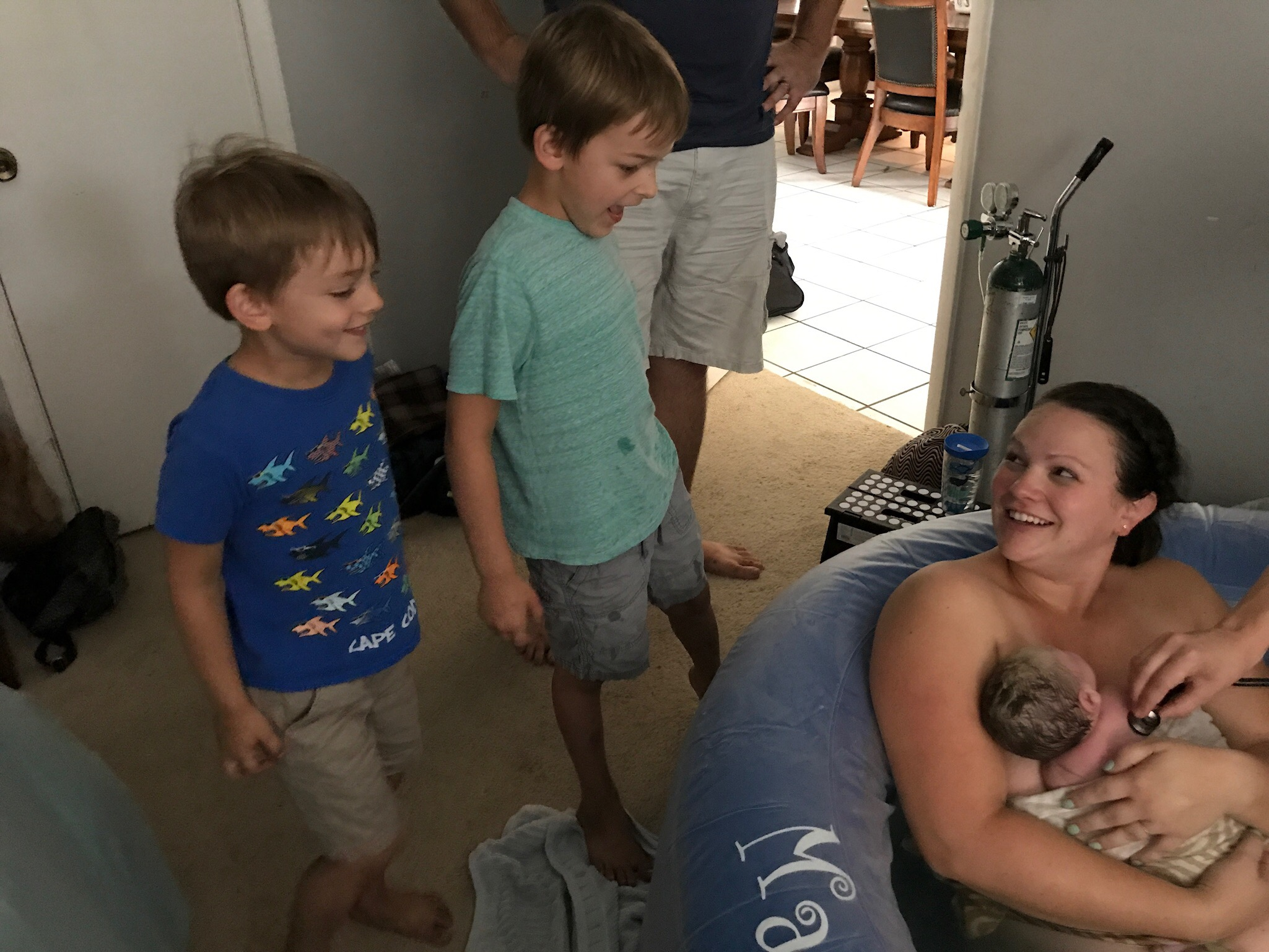 The boys meeting Evan just minutes after his birth.