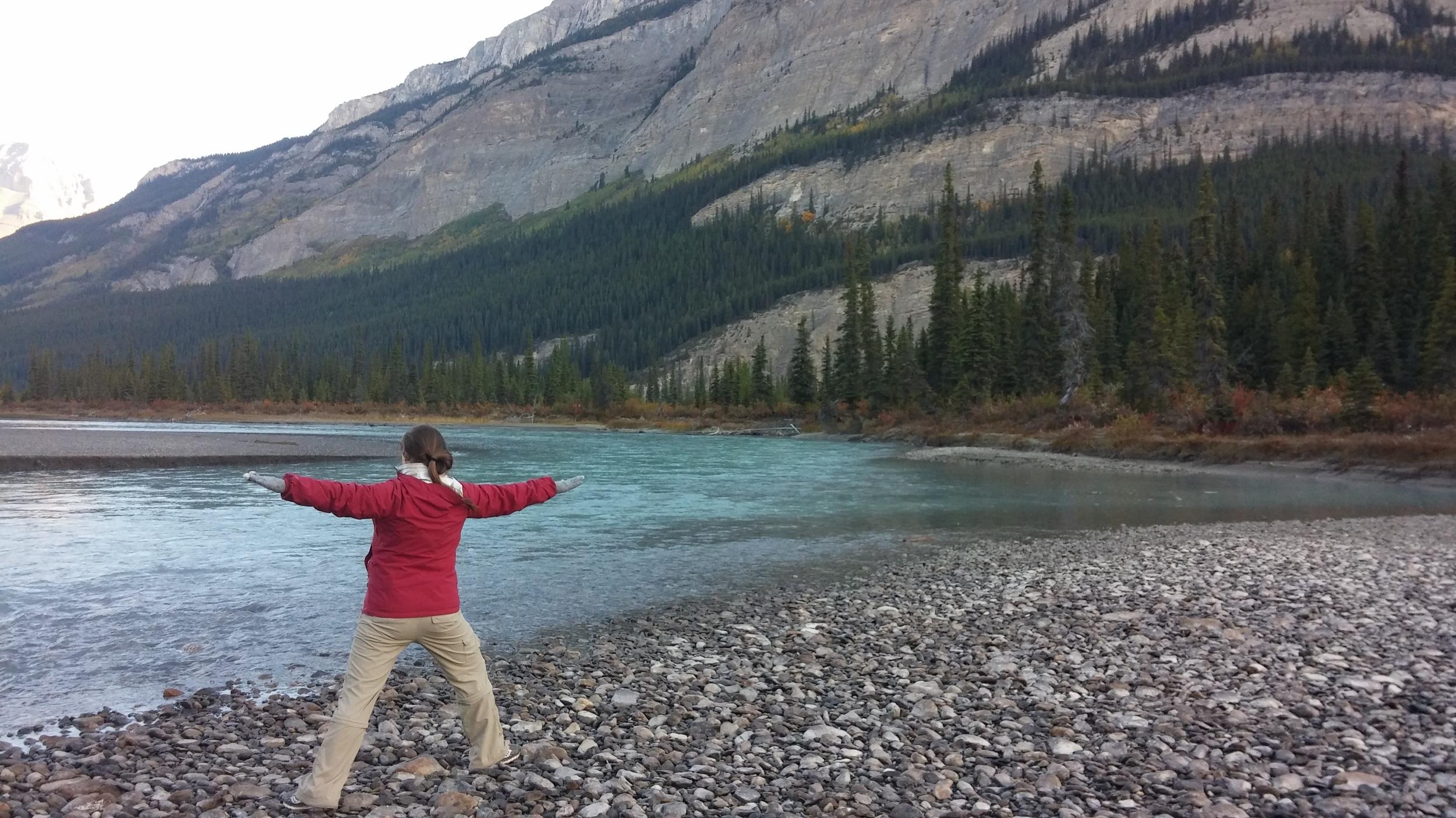 Morning yoga along a river in Banff National Park, Alberta.