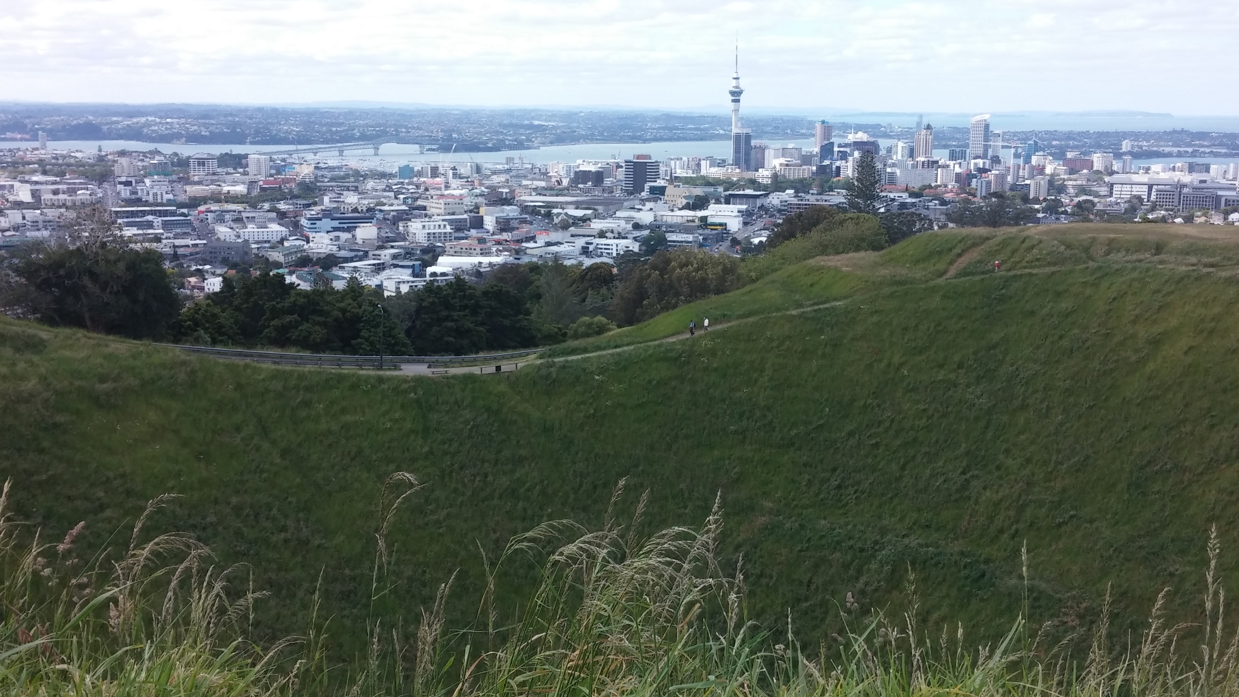 Hike up to Mount Eden's volcanic crater after campervan scouting.