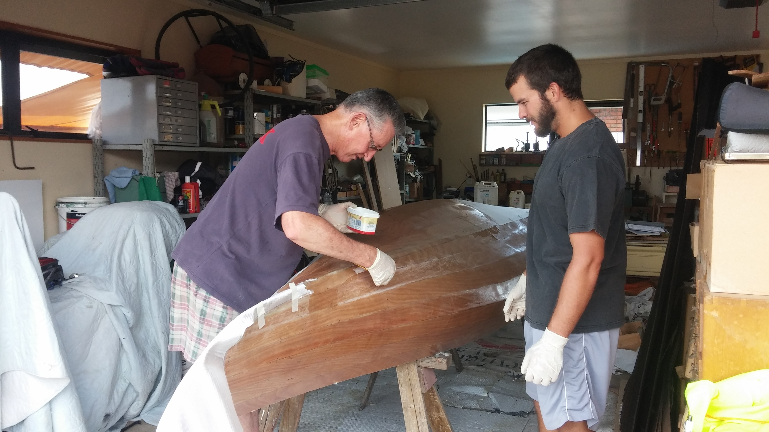 Rex and Adam working on the canoe.