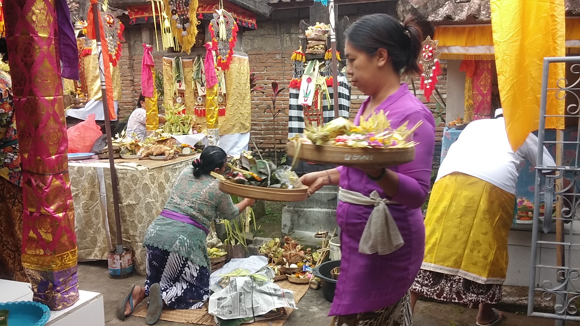 Everyone preparing the offerings in the family temple.