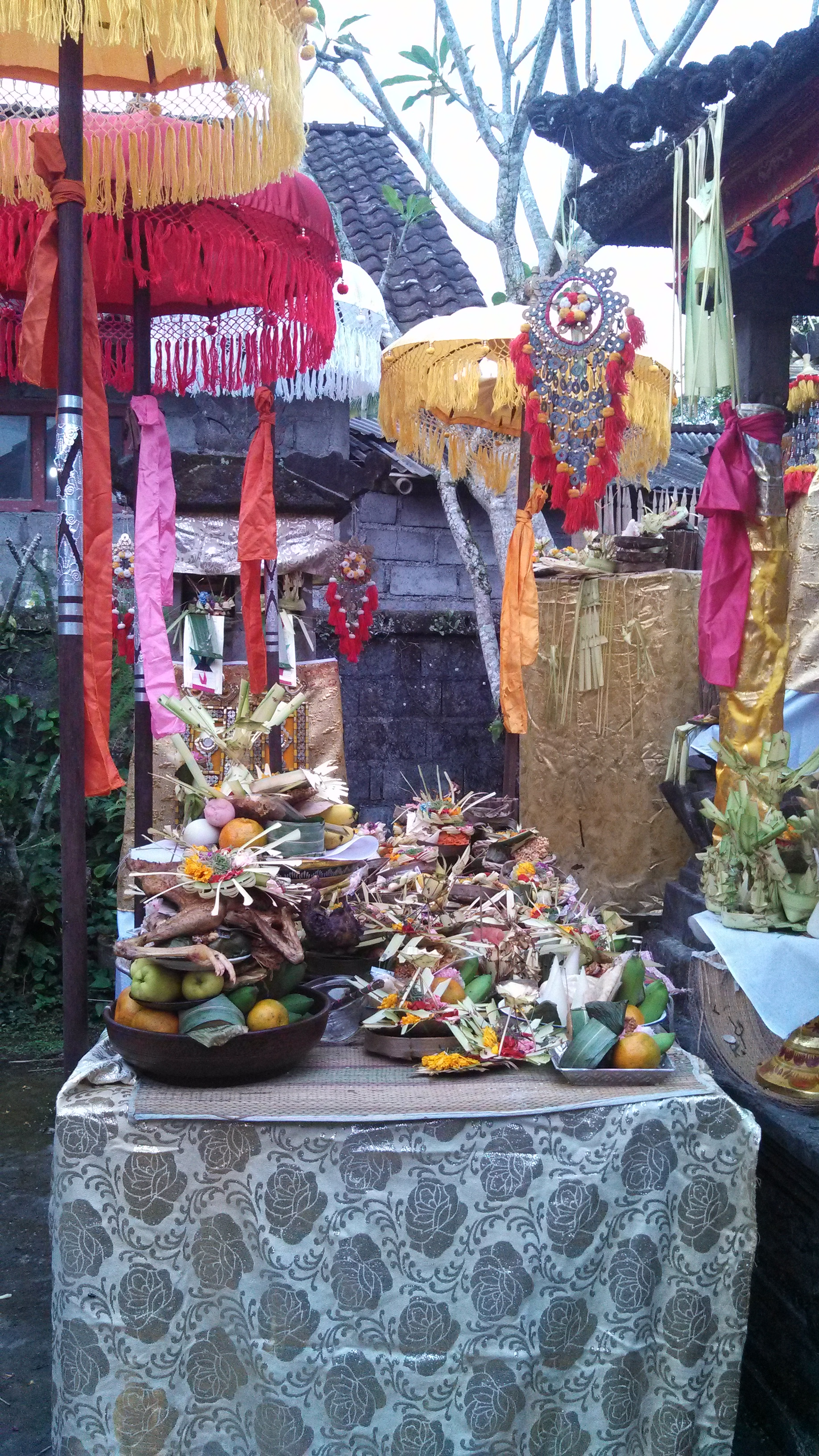 The camera just can't capture it all. Heaps of offerings were on the tables, in the temple's nooks and crannies, and on the ground.
