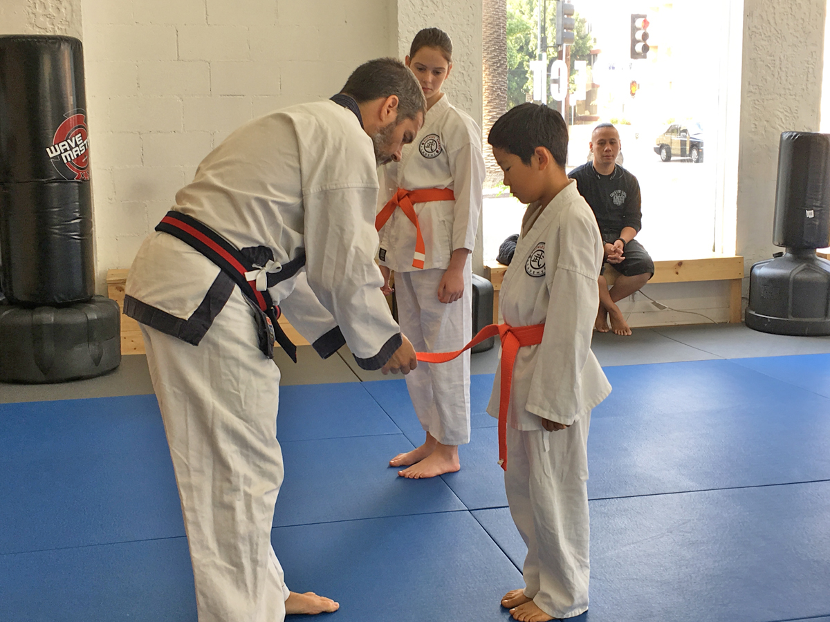 Two more 7th Gup recipients - orange belt with a stripe