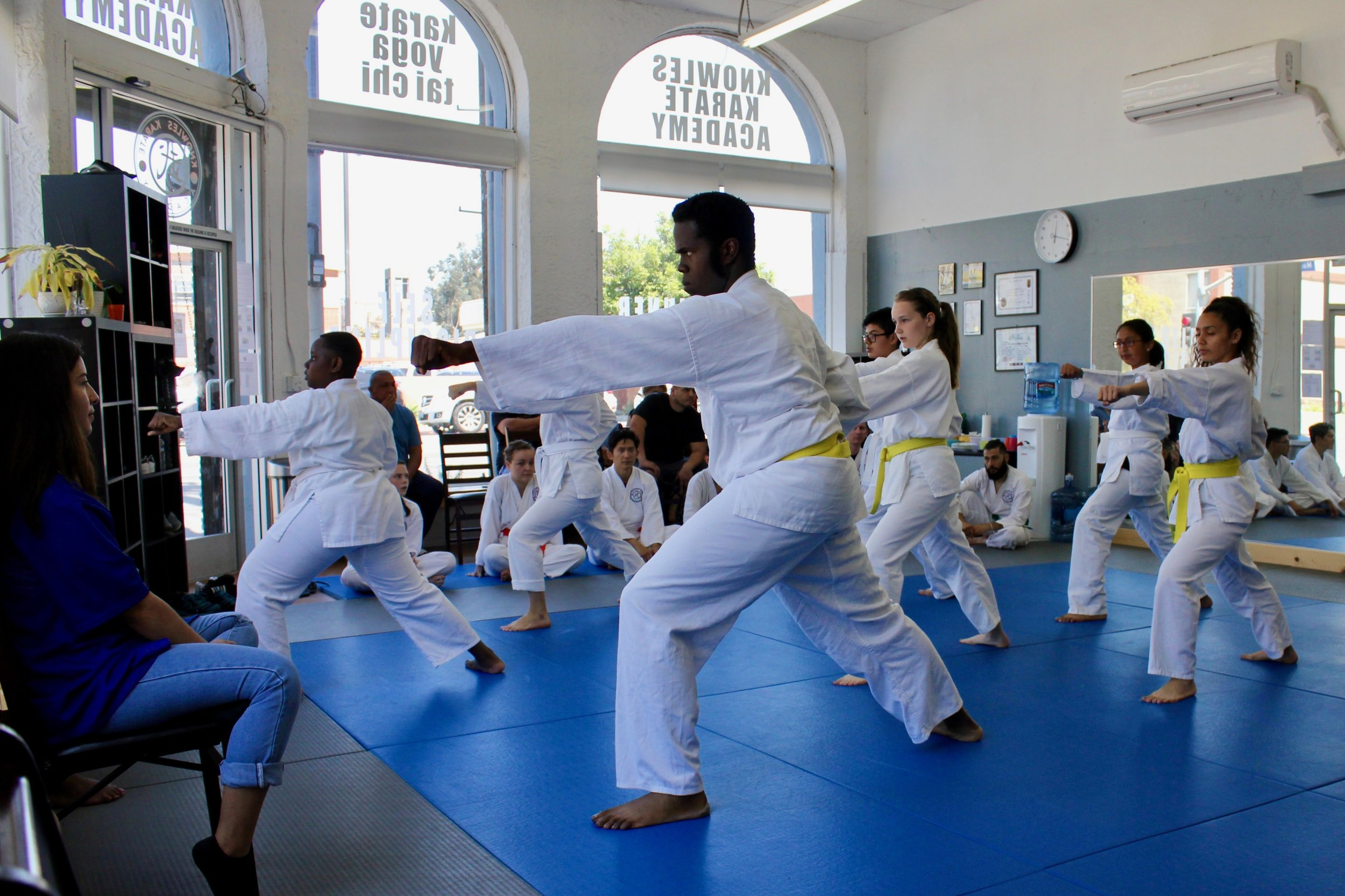 White and yellow belts demonstrating their form