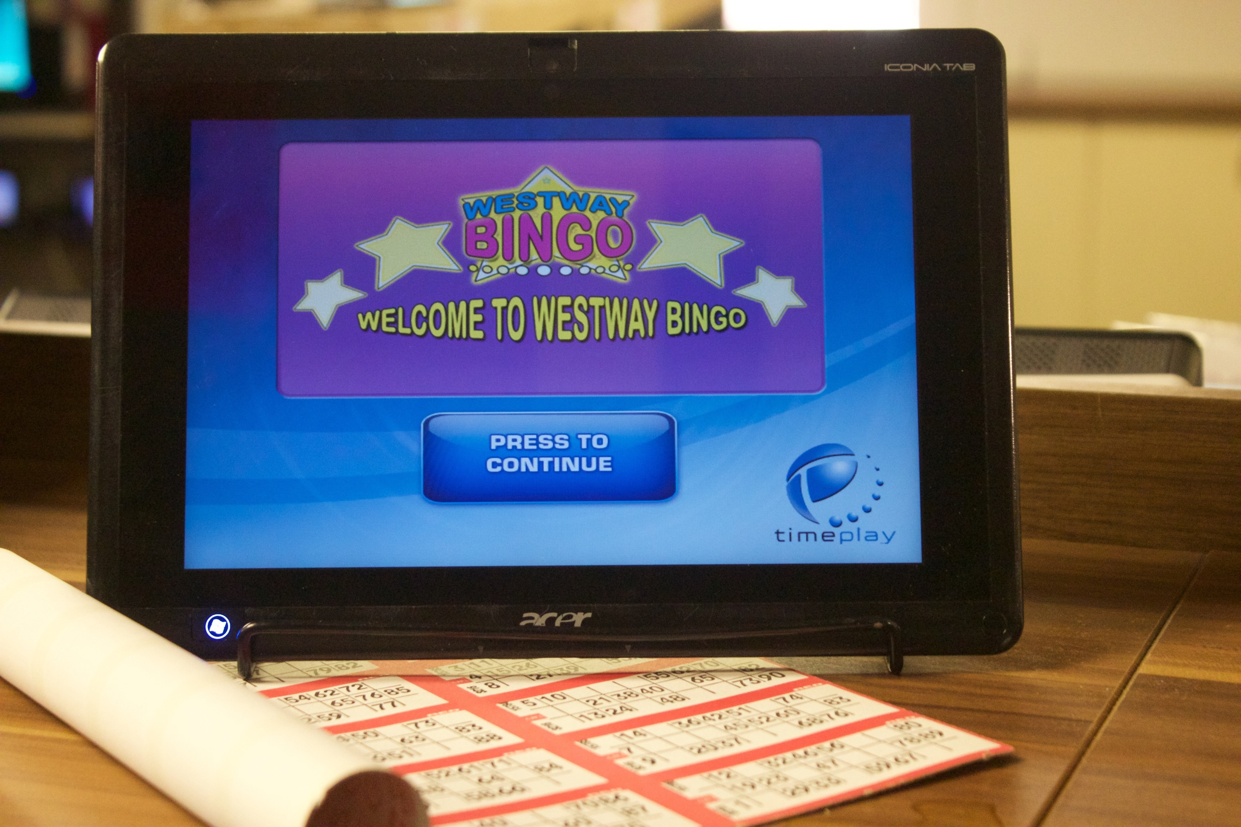 ELECTRONIC BINGO - Using our handheld touch screen pads (known as Genies) allows you to purchase more than the standard 6 tickets per game, thus increasing your chances of winning. You can purchase a 'package' consisting of a certain numbers of tickets for each game as well as extra scoops from the sales desk as you enter the club. The Genie on which the game is played automatically marks the numbers off the tickets when each number is called.  It will place the tickets in order ranking the best tickets in play to the top of the screen. When all the numbers are marked off to win you still must shout 'CHECK' in order to attract the caller's attention and stop the game. You must stop the caller before the next number is started.  If you do not, your claim will be invalid (N.B The last number called is the checking number.) A member of staff will come and validate your claim.  Once validated you will receive your prize money.  Always check your prize money immediately as any errors cannot be rectified later.