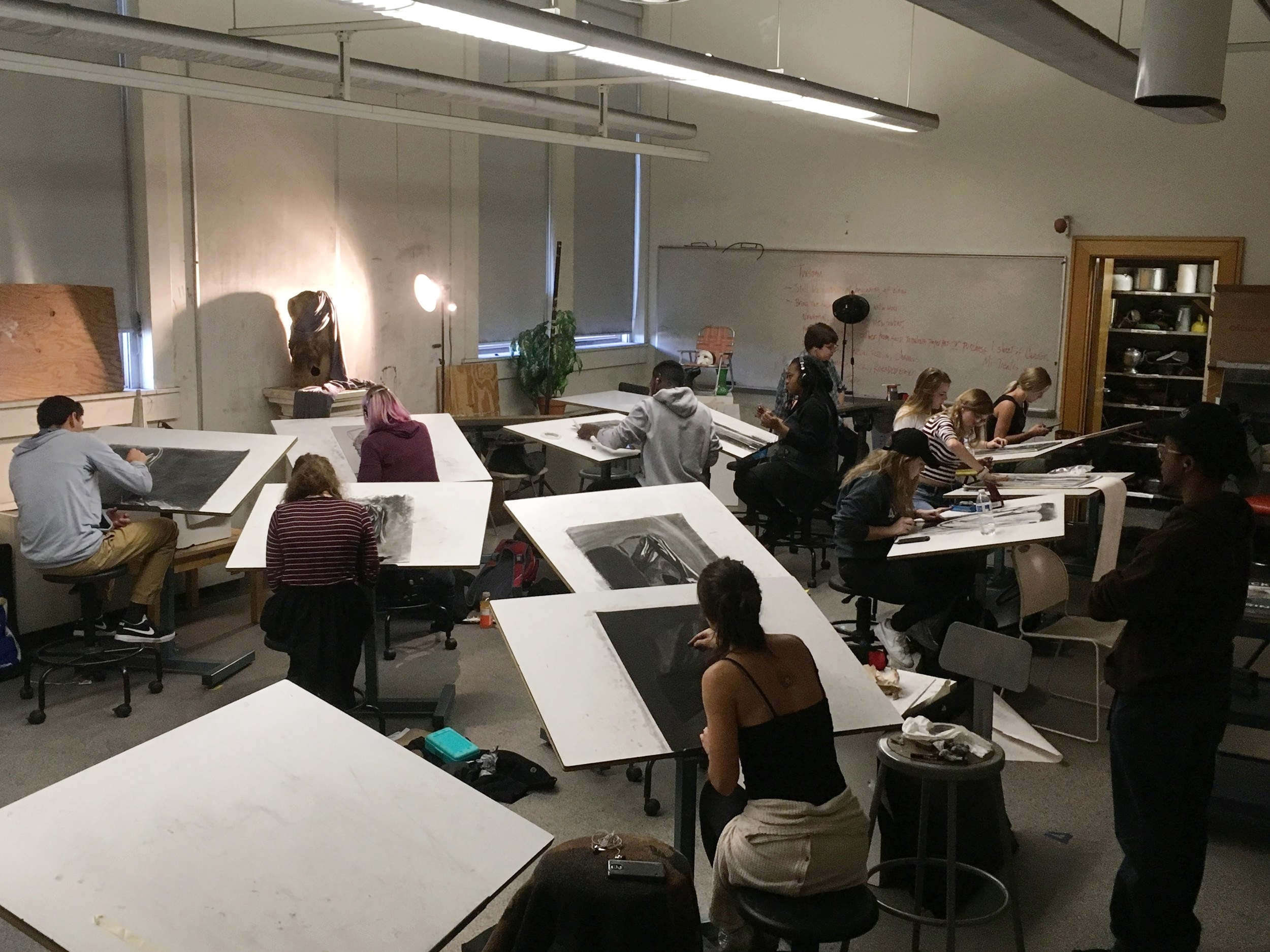 Students choose between three drapery still-life sets ups and make a reductive charcoal drawing.