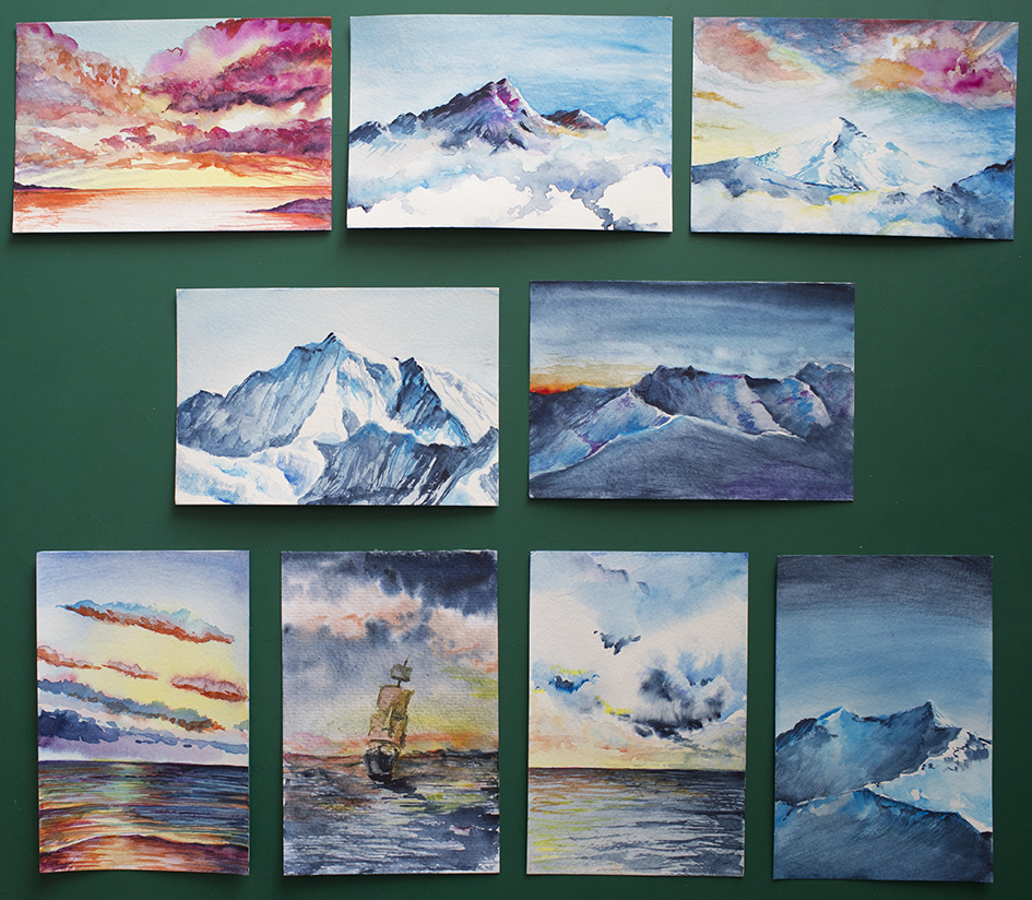 Example of handmade watercolor postcards that I send to my Patreons of $10 tier or higher.