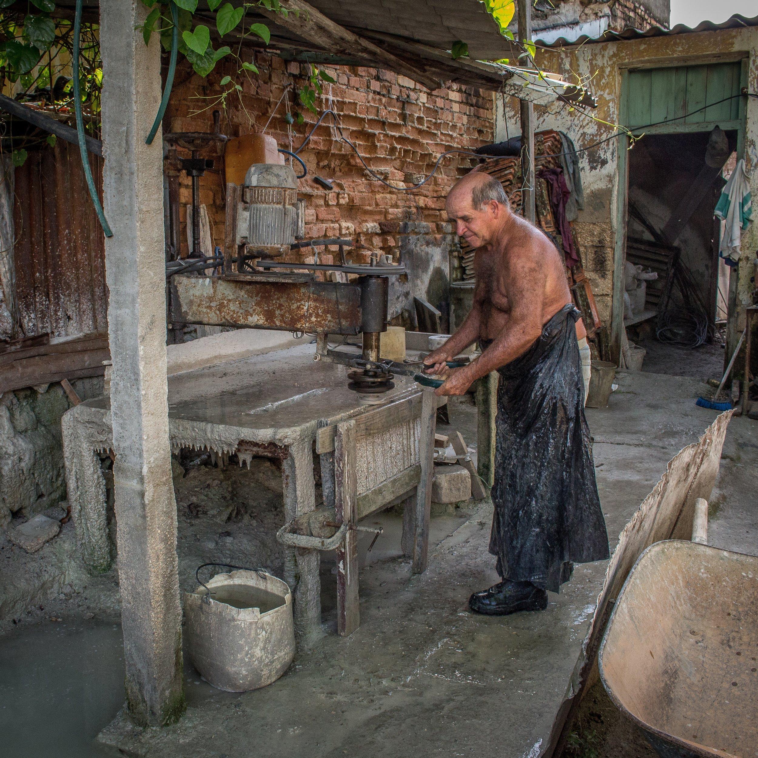 Armando, working in his shop
