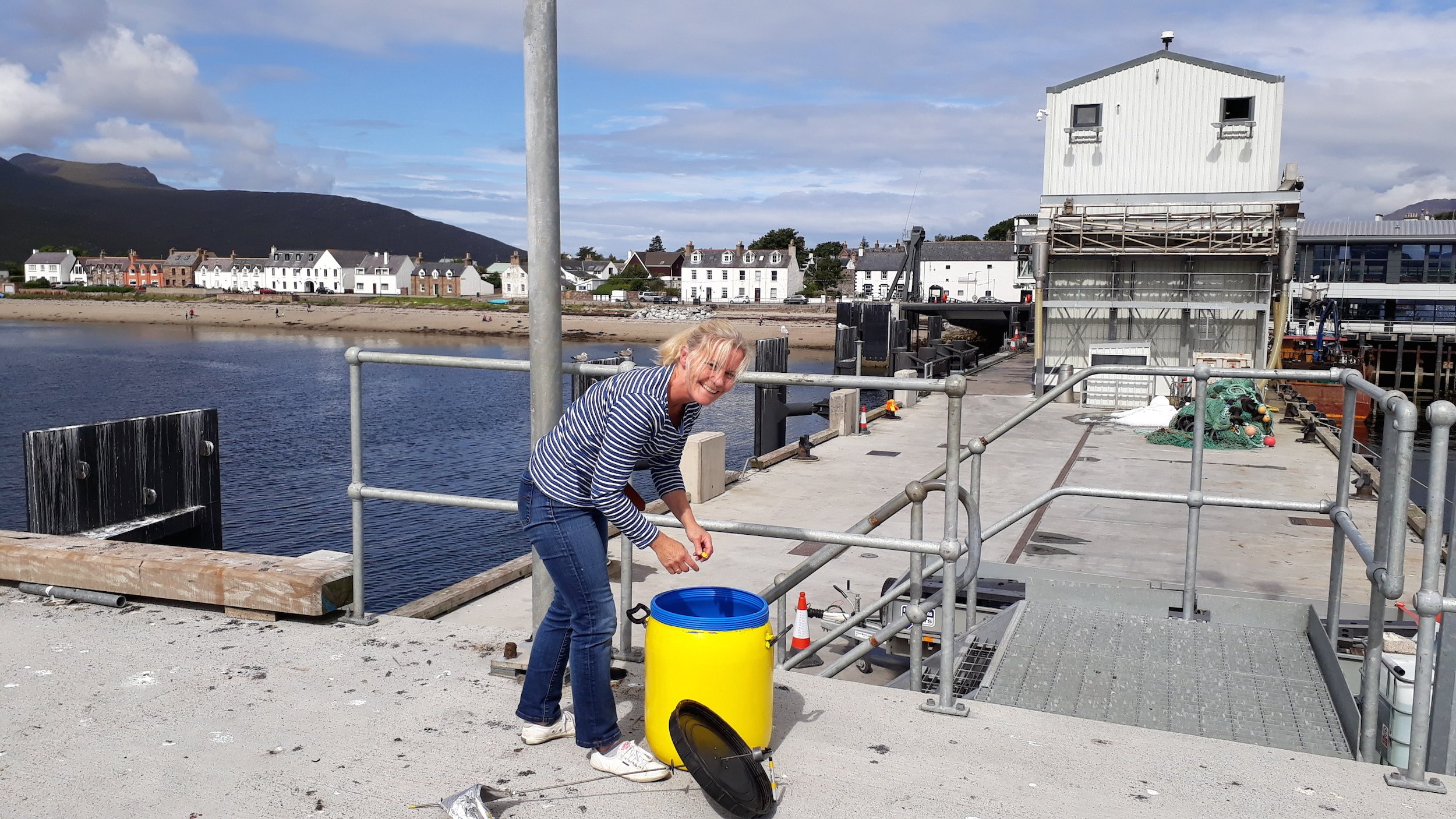 Me (Meg Rodger) installing the Storm Barrel on the end of Ullapool ferry pier for 2 weeks of wind drawing.