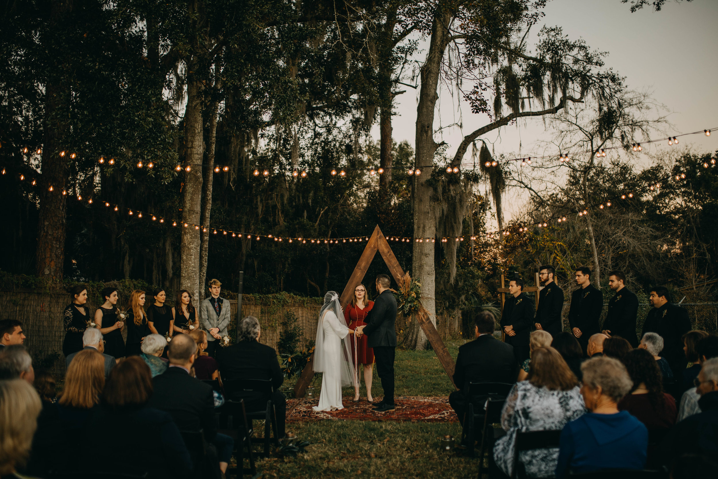 Boho Outdoor Ceremony with String Lights | American Traditional Tattoo Themed Eco Friendly Dark Florida Wedding