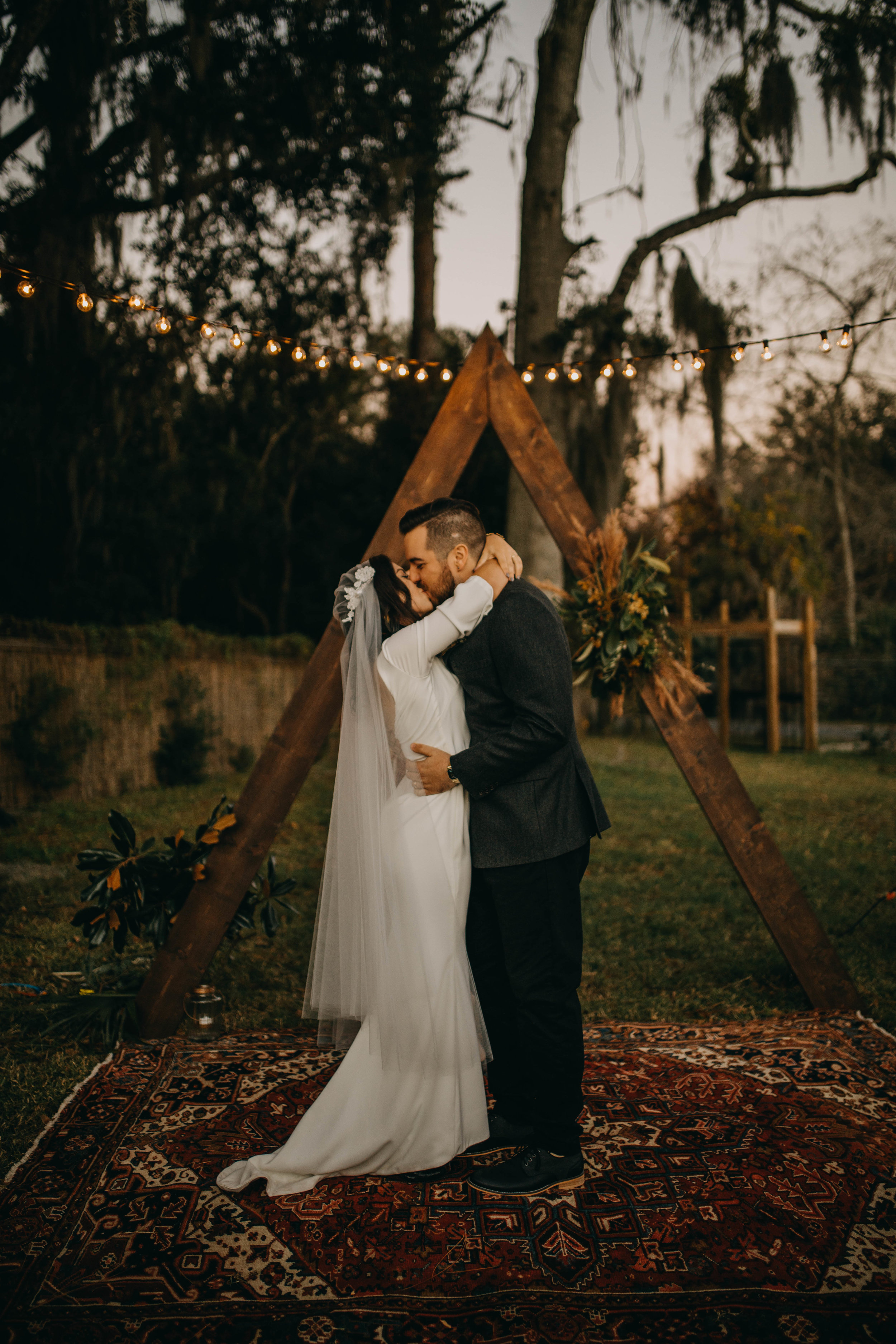 First Kiss Picture | American Traditional Tattoo Themed Eco Friendly Dark Florida Wedding