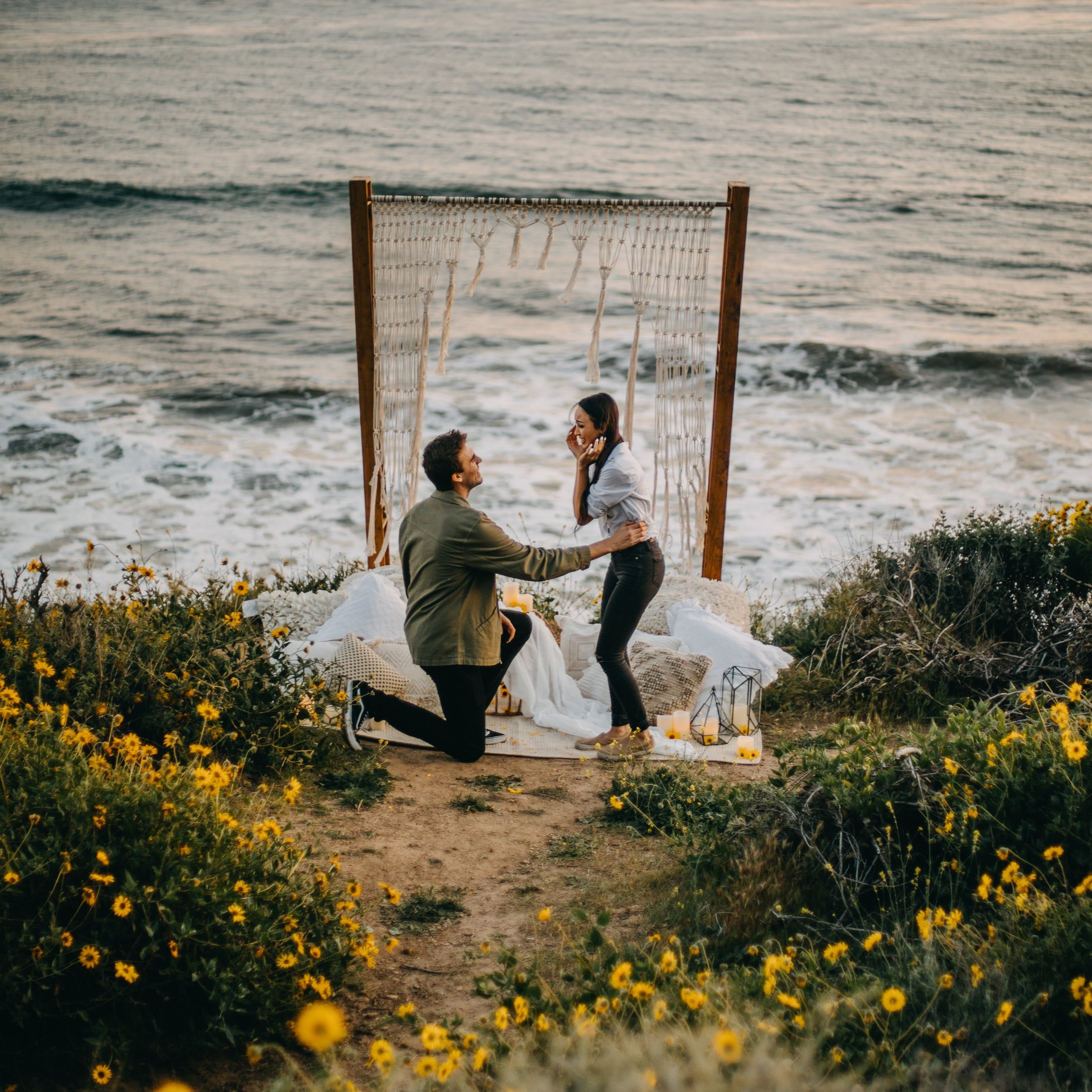 Malibu Proposal - Chad & Sophia's beautiful sunset proposal on a cliff in Malibu, surrounded by blooming flowers.
