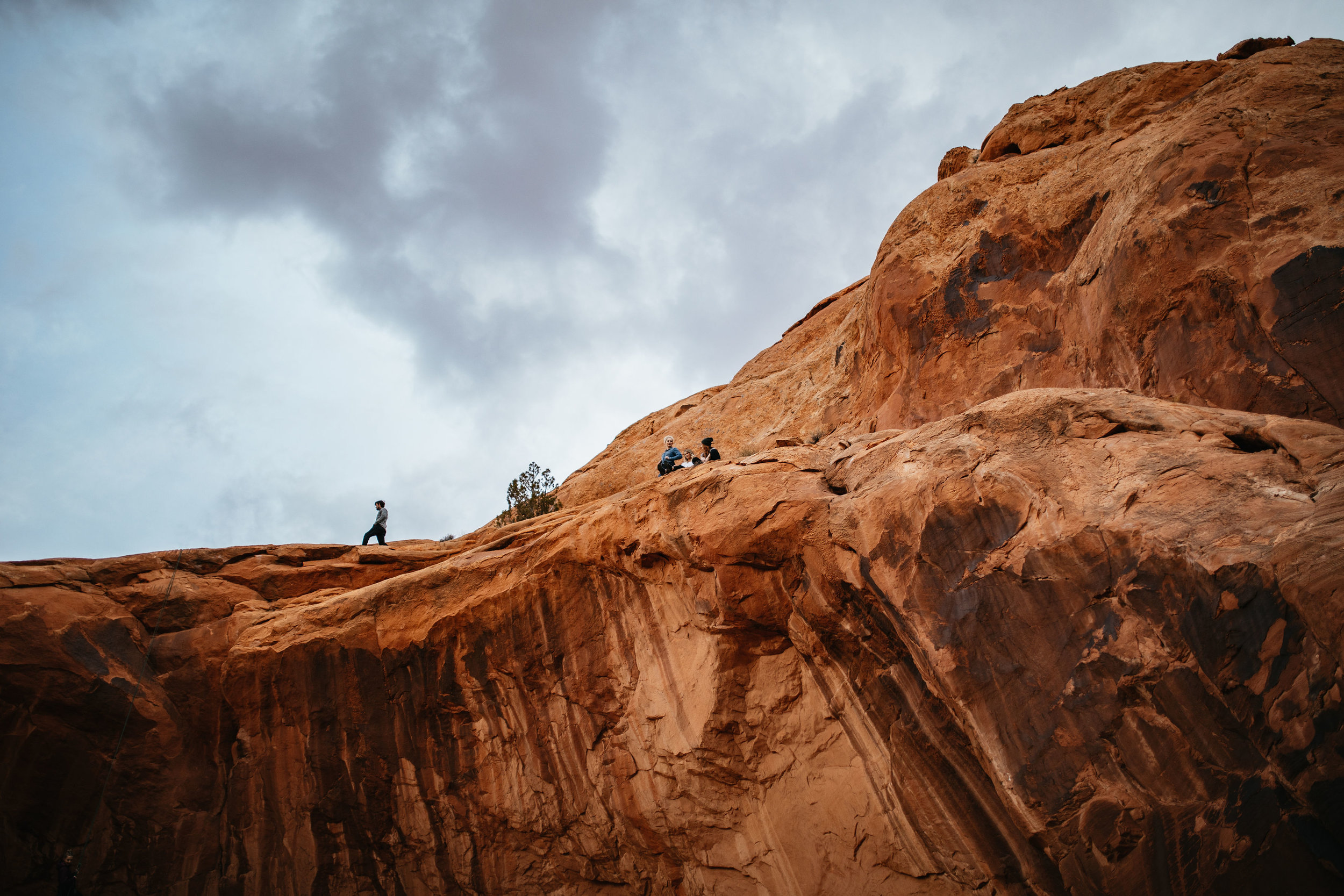 Sitting on a cliff in Moab, Utah