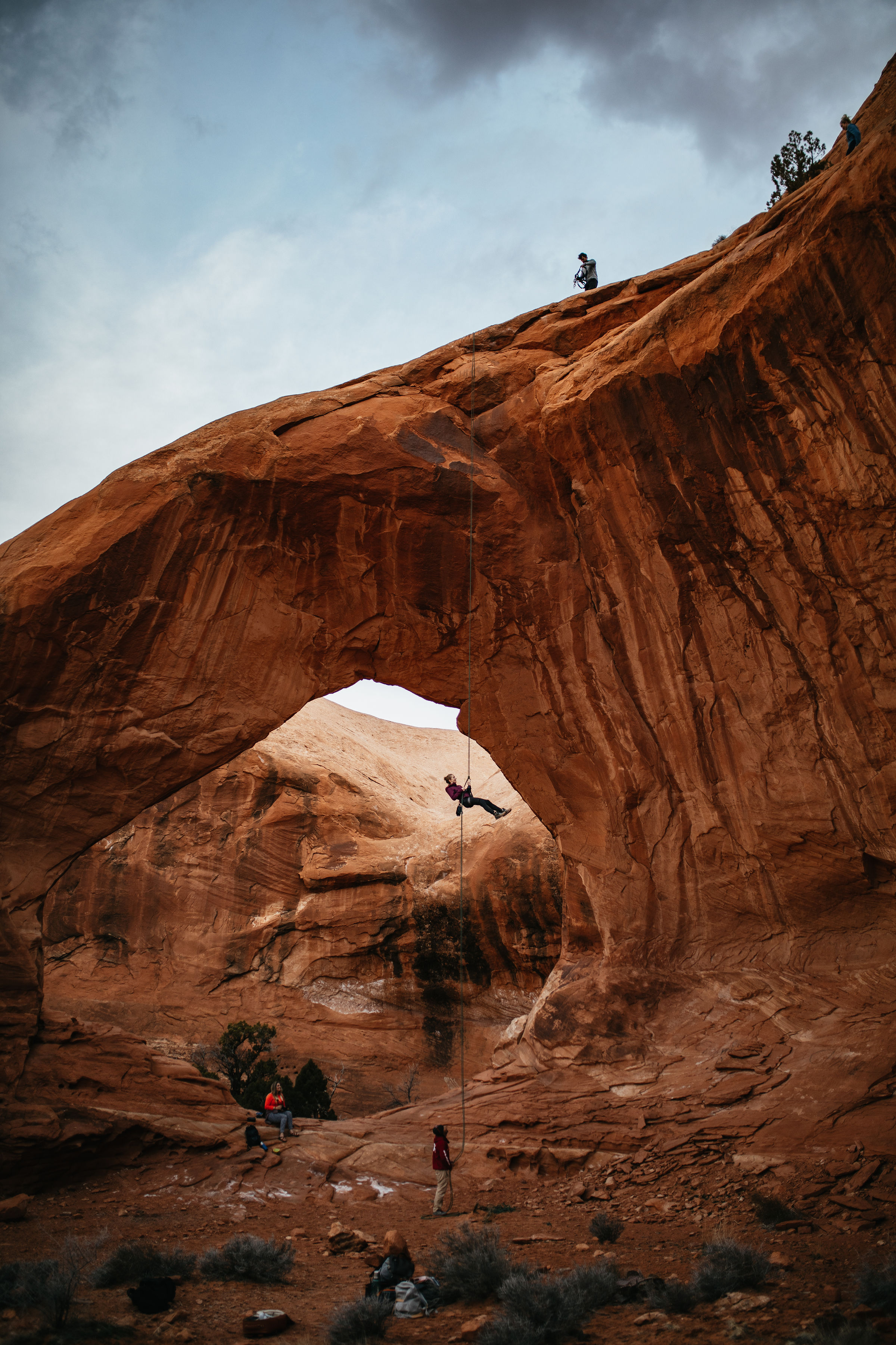 Repelling down a large arch in Moab, Utah | Arches National Park Photography