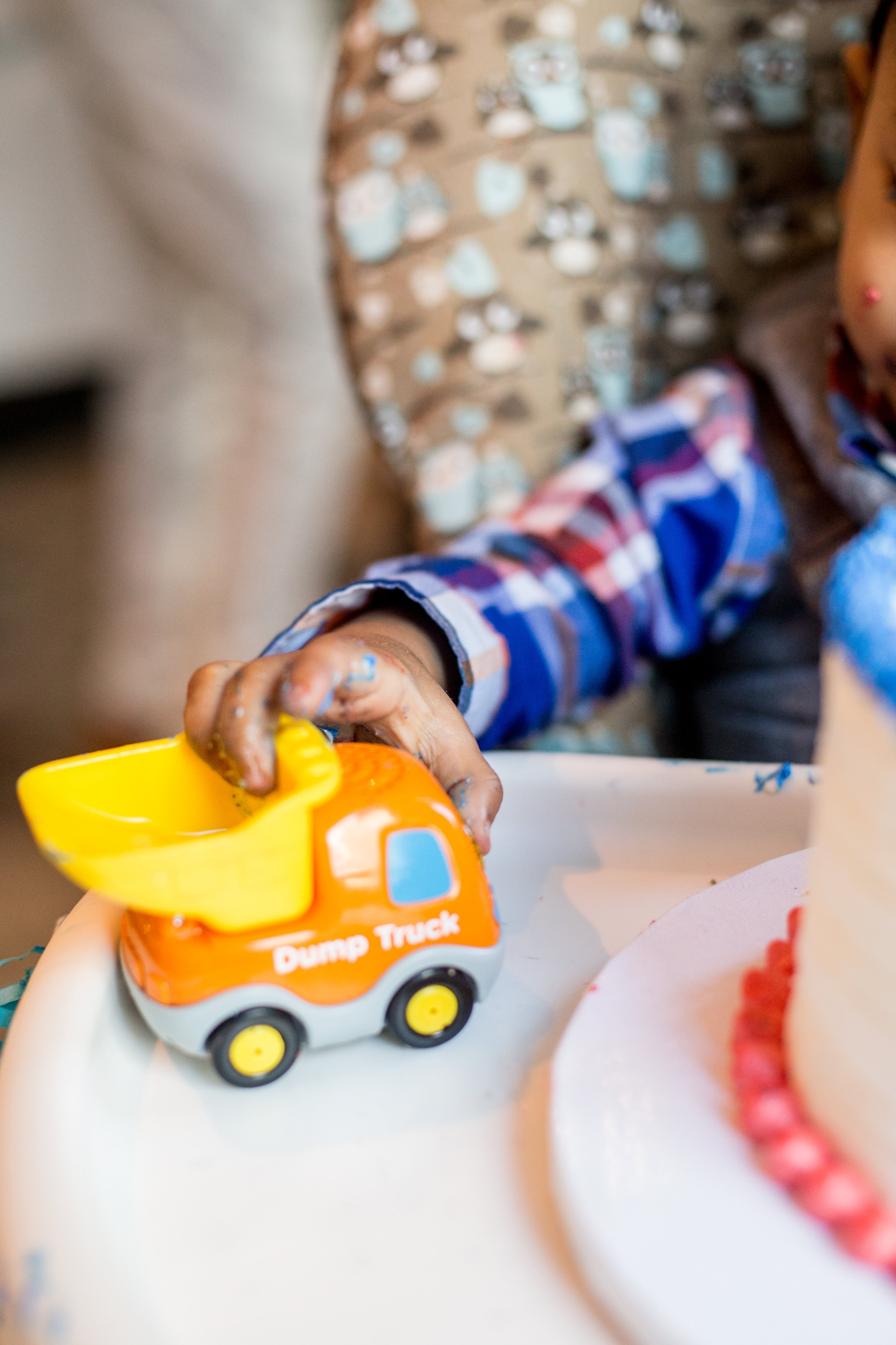 little boy with dump truck and birthday cake