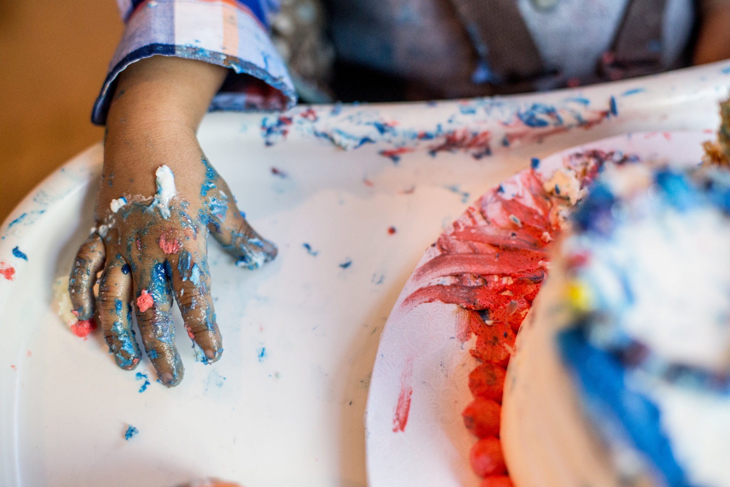 First birthday cake smash with dirty hands