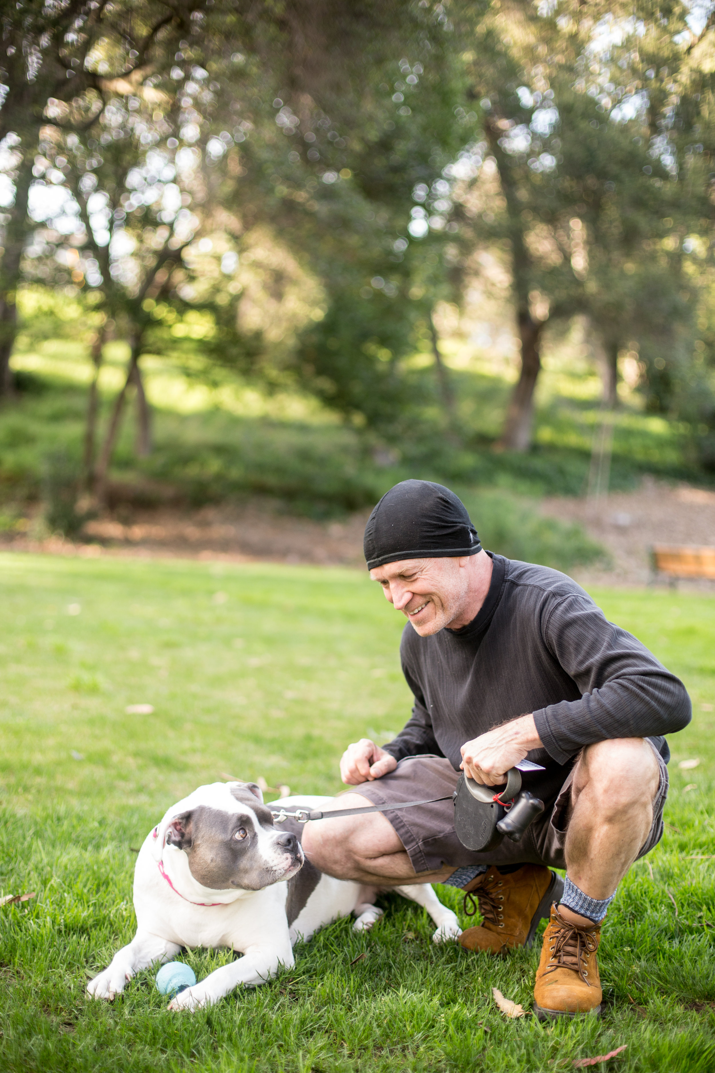 Man with dog at Saratoga Park in San Jose