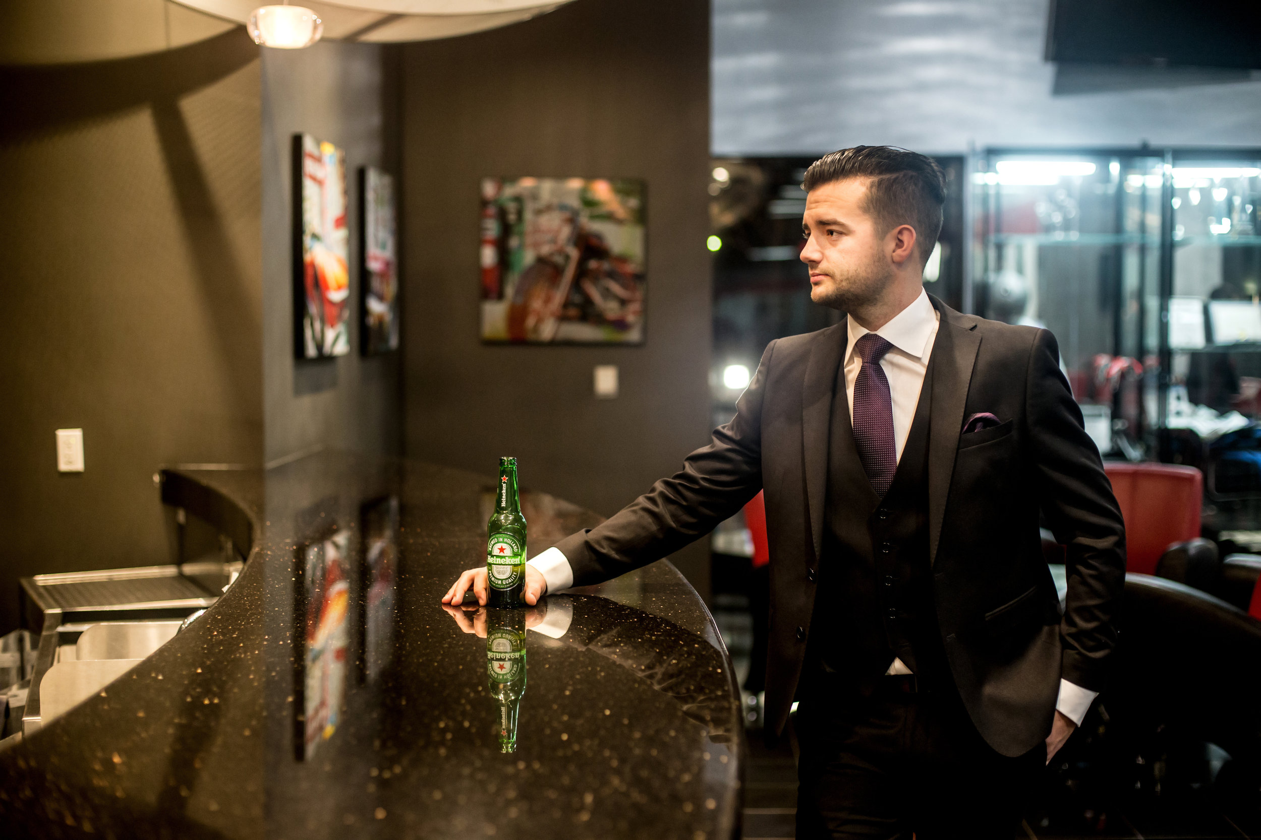 Male model with beer at a bar wearing a Franco Uomo Suit in San Jose, California