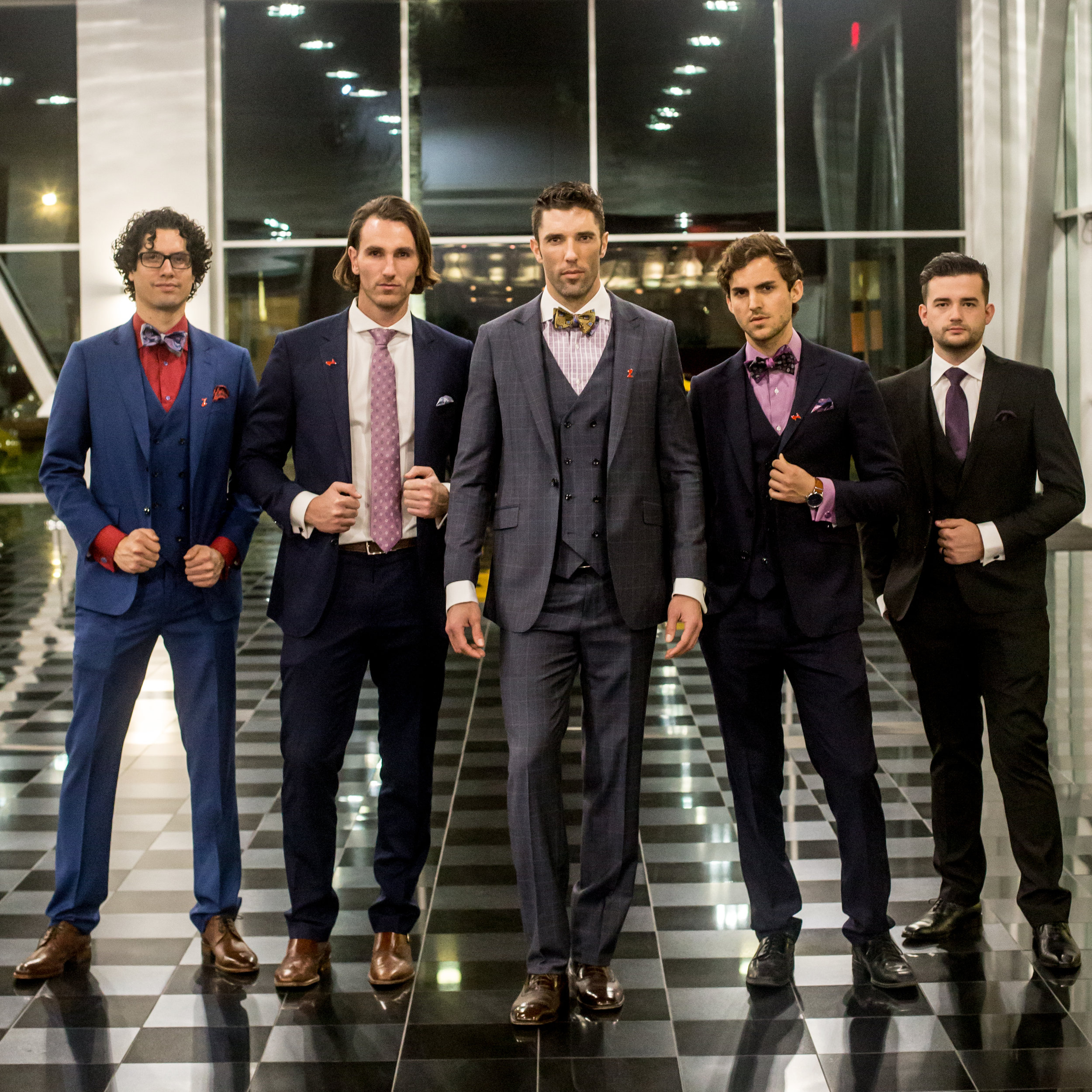 Male models wearing Franco Uomo suits at Club Auto in San Jose at a Porsche event.