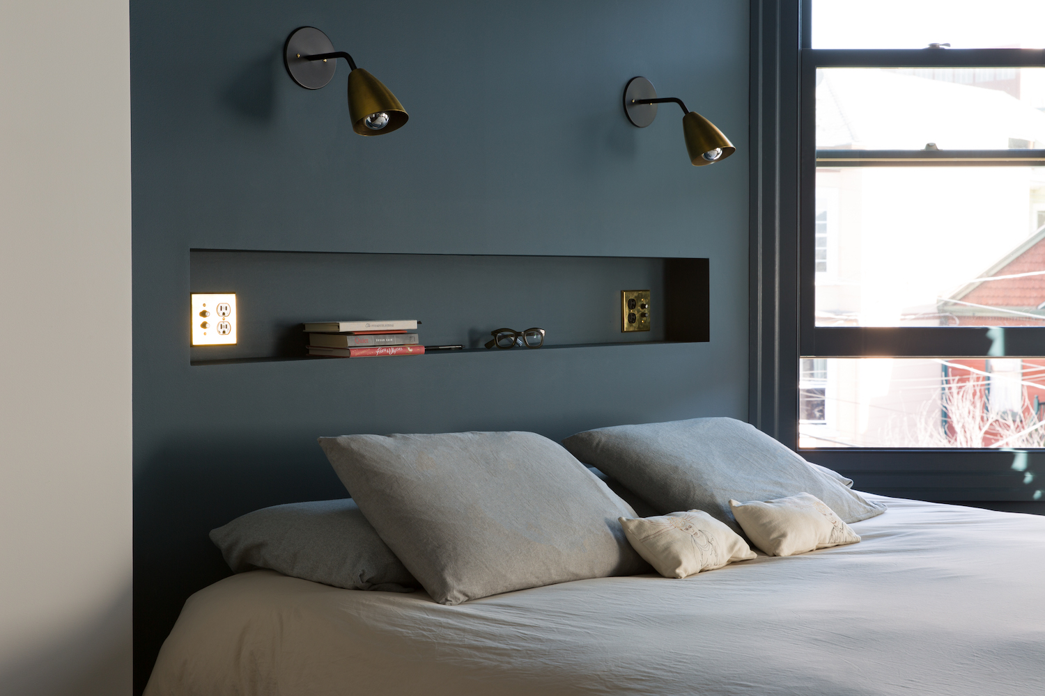 bedroom with custom niche and wall lighting.jpg