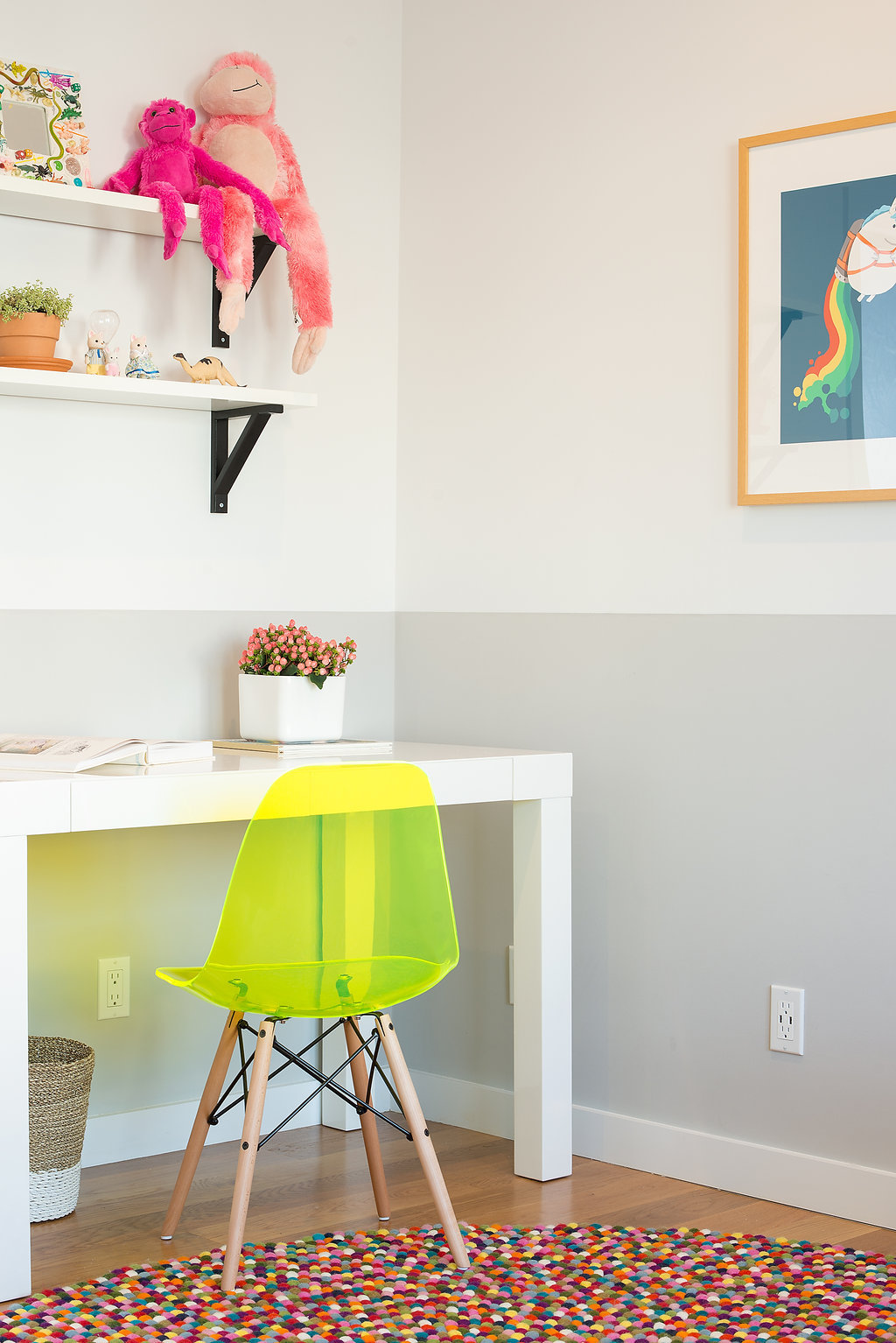 kids desk area with colorful dotted rug and white desk and neon chair and colorful accessories.jpg