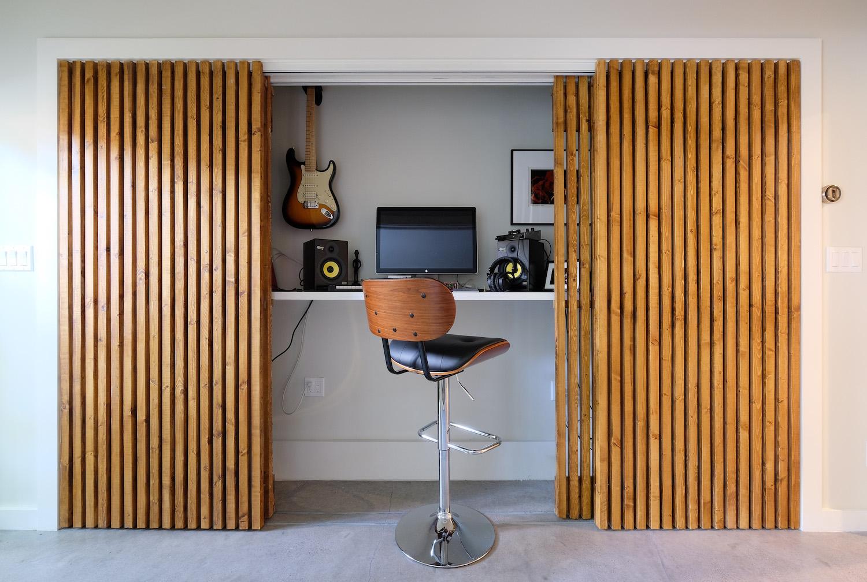 hidden music closet with custom wood sliding doors.jpg