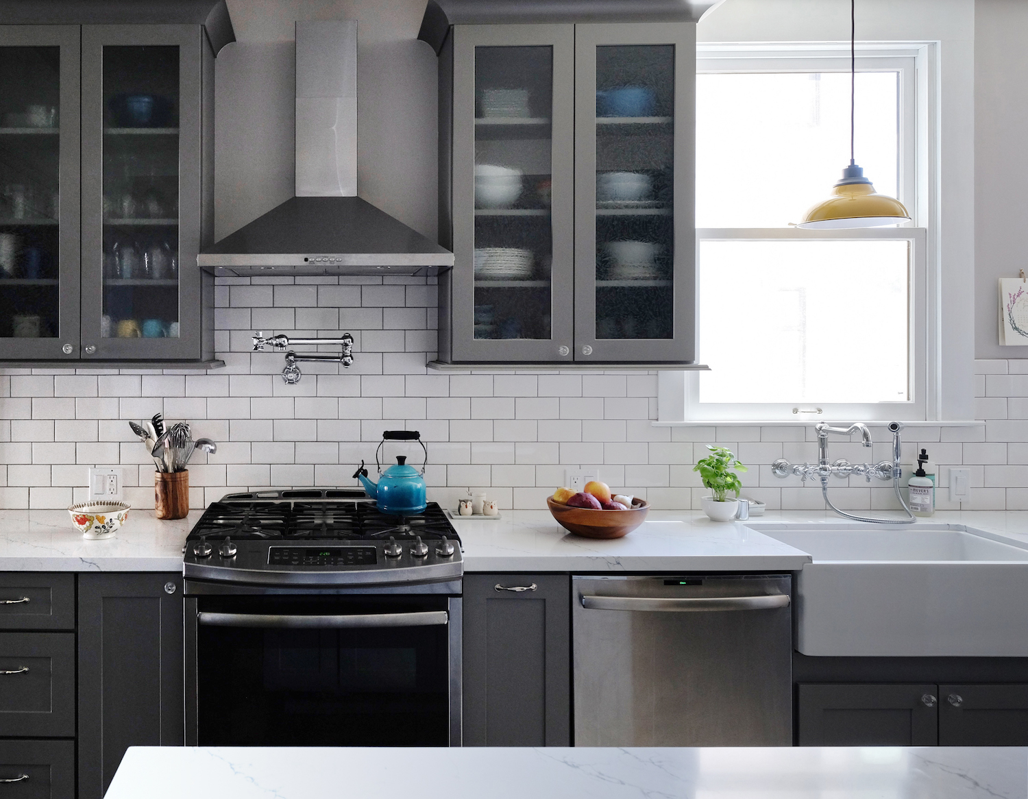 modern grey and white kitchen with yellow light fixture.jpg