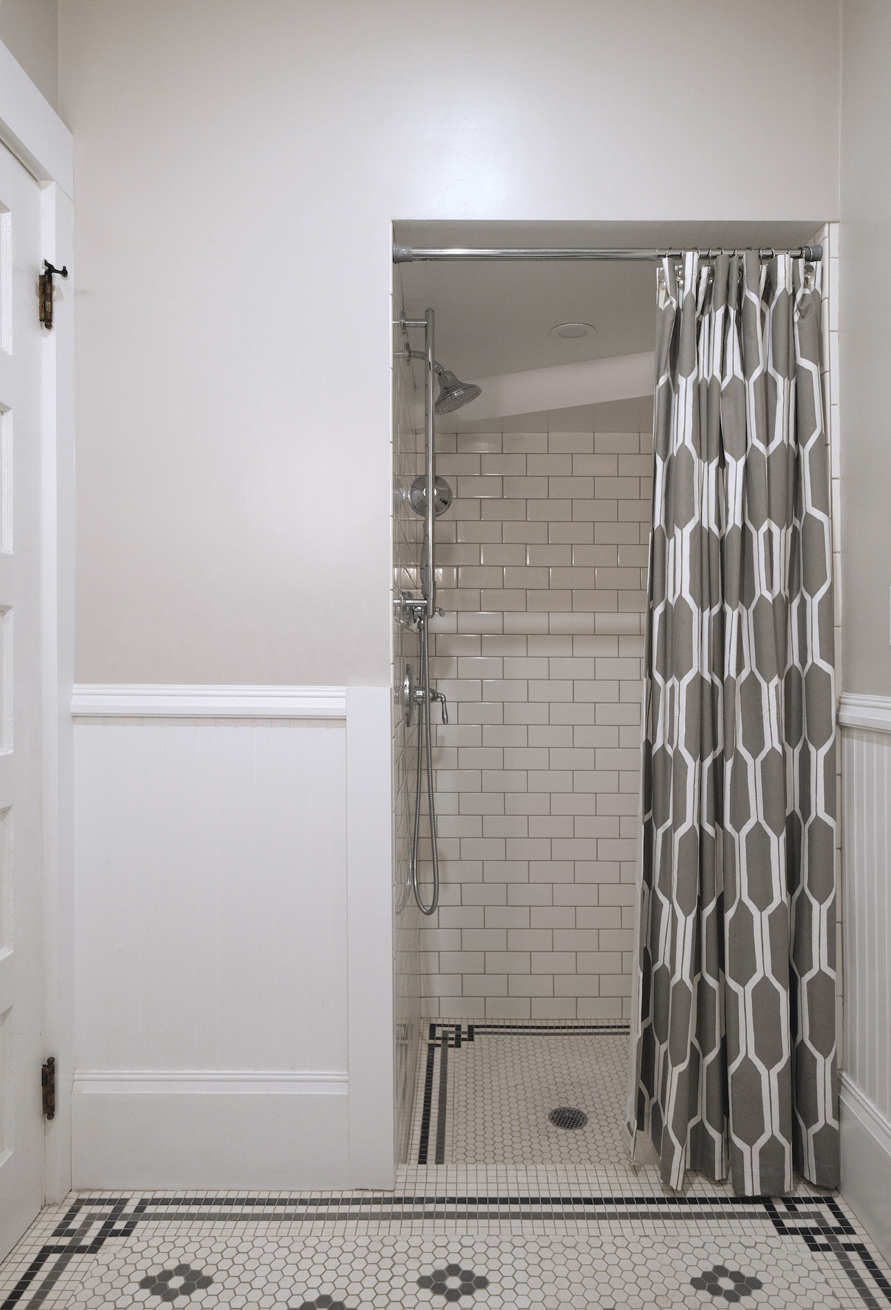 white bathroom with mosaic floor tile and walk in shower.jpg