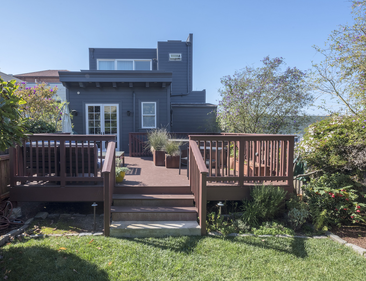 home exterior with deck and new remodeled addition.jpg