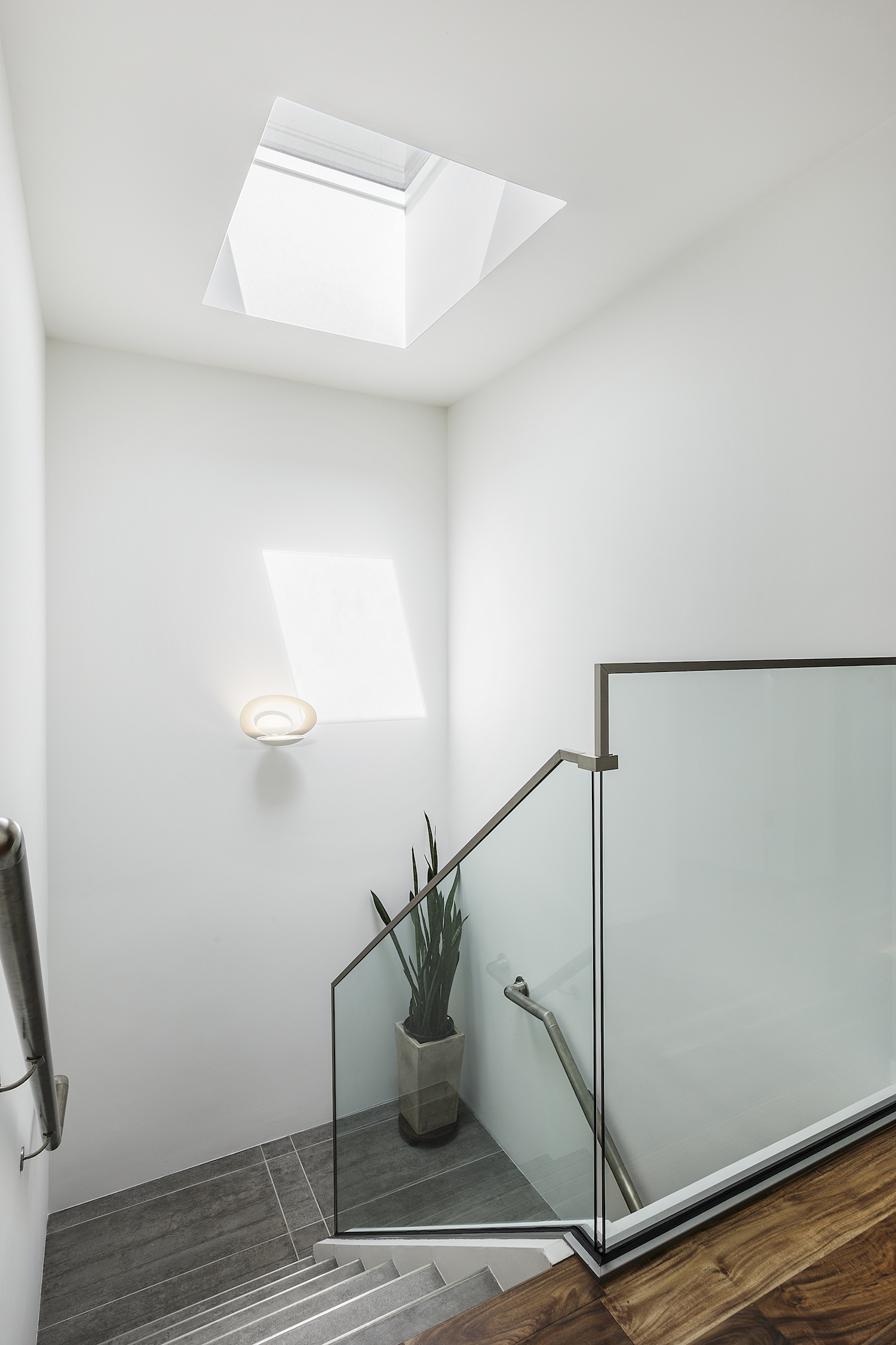 grey tile staircase with glass railing.jpg
