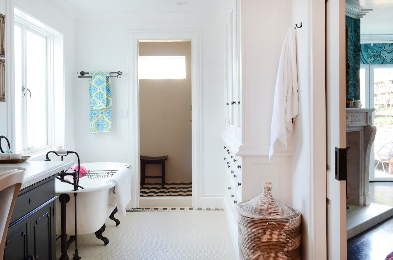 bathroom with white tile floors and white walls and clawfoot tub and black fixtures.jpeg
