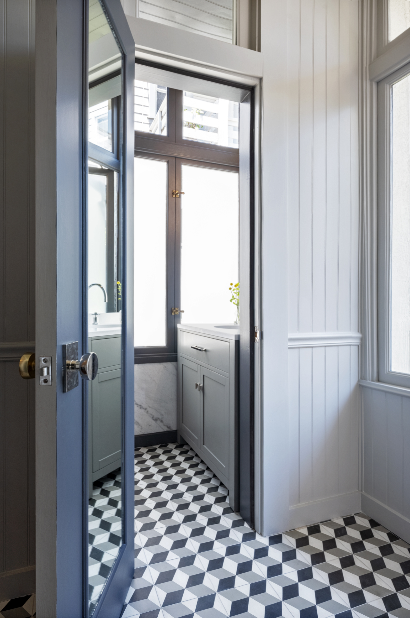 san francisco bathroom and entry remodel with ceramic tile and white marble.jpg
