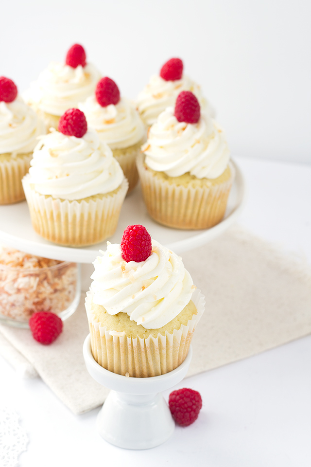 Coconut Cupcakes with Raspberry Filling from  Cookie Dough and Oven Mitt