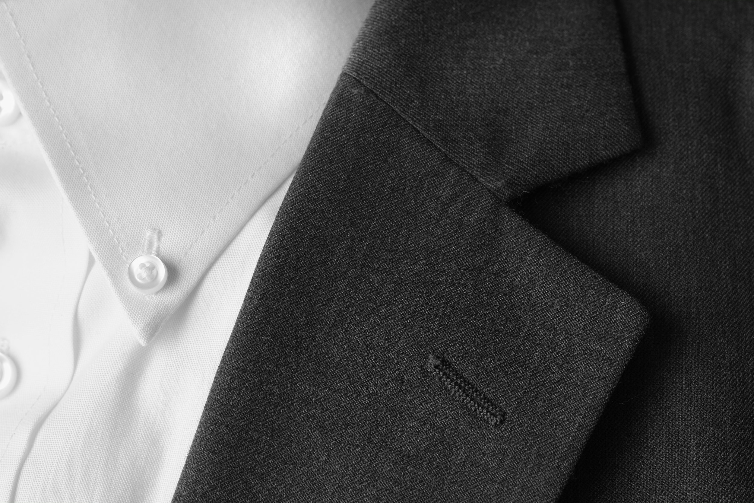 Notch lapels look like a Pacman-shaped mouth between the collar and the jacket flap. The angle is usually between 75 and 90 degrees. It's the most evergreen and classic type of lapel suitable for most body types. If you're only going to have one coat, this is the lapel you want to go for. Its versatility allows you to wear it to both casual and formal events, from job interviews to weddings. The notch is usually what you see with sports jackets as well.
