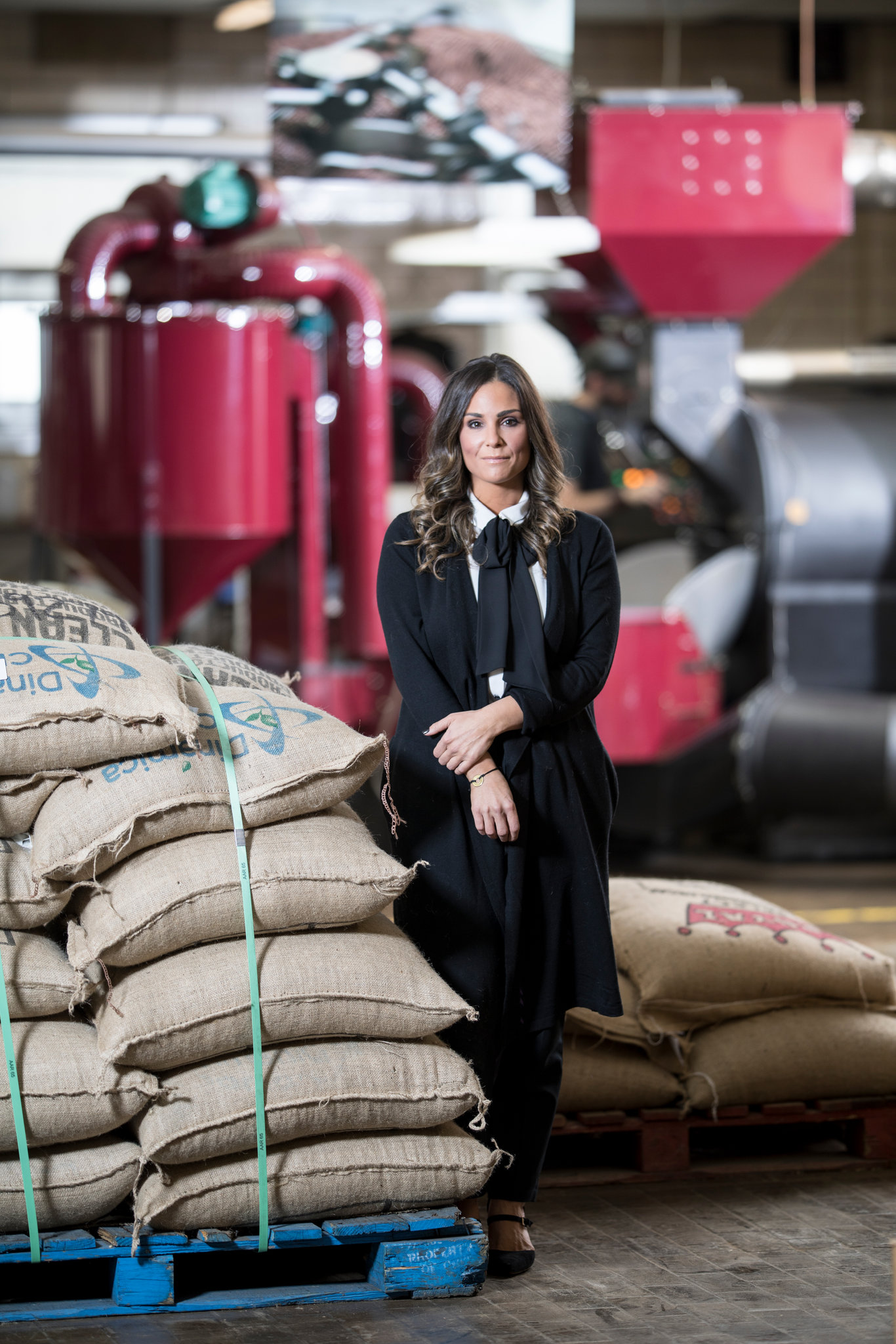 """Alyza Bohbot at the headquarters of Alakef Coffee Roasters, which was founded by her parents. """"I don't want to come in and keep things ho-hum,"""" she told them.CreditCreditJenn Ackerman for The New York Times"""