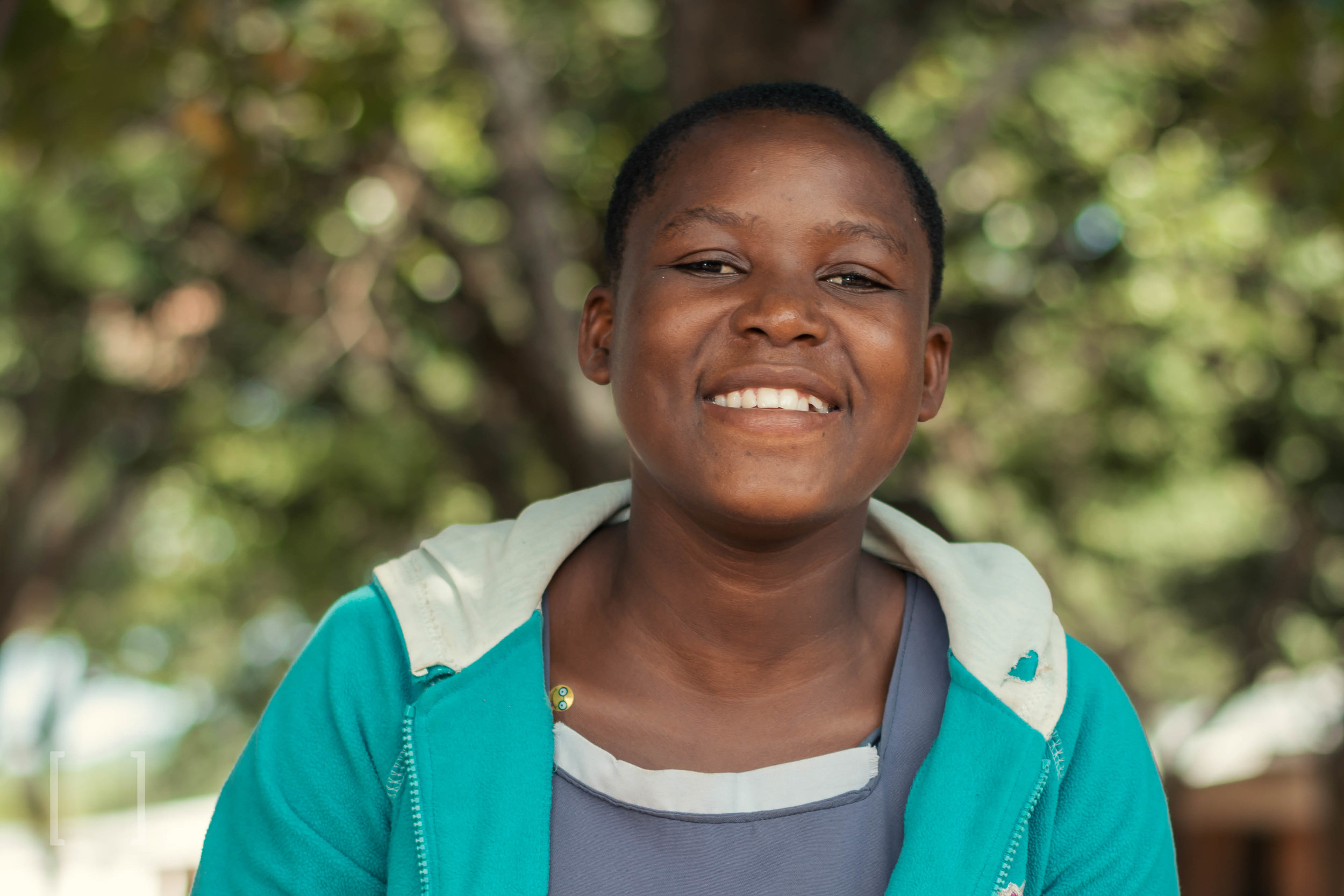 Janet - Janet is content living at the orphanage where she can eat, play with lots of friends and go to school. She wishes to be a lawyer. Be Janet's advocate!