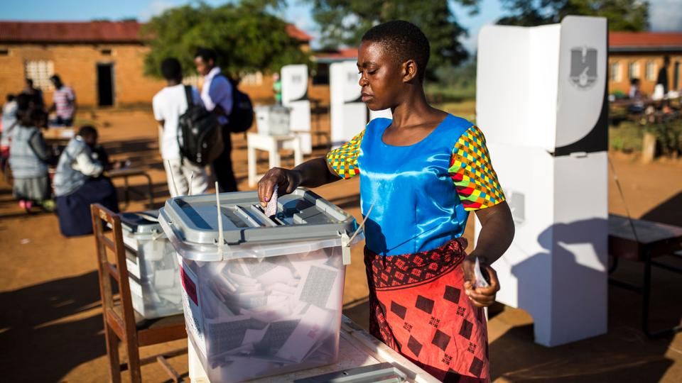 A woman casts her vote at CCAP Primary School polling station during the Malawi Tripartite general elections in Mzuzu, on May 21, 2019. Photograph: Associated Foreign Press.