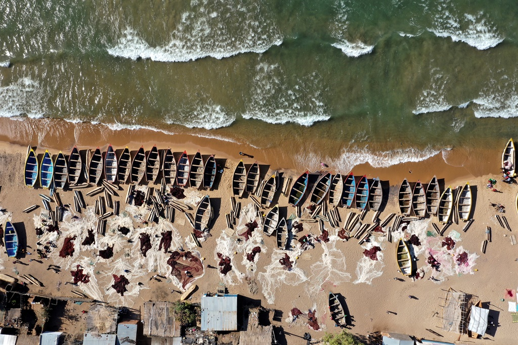 Aerial view of fishing boats on the shore of Lake Malawi at the Senga village. (Photo: Gianluigi Guercia, Associated Foreign Press.)